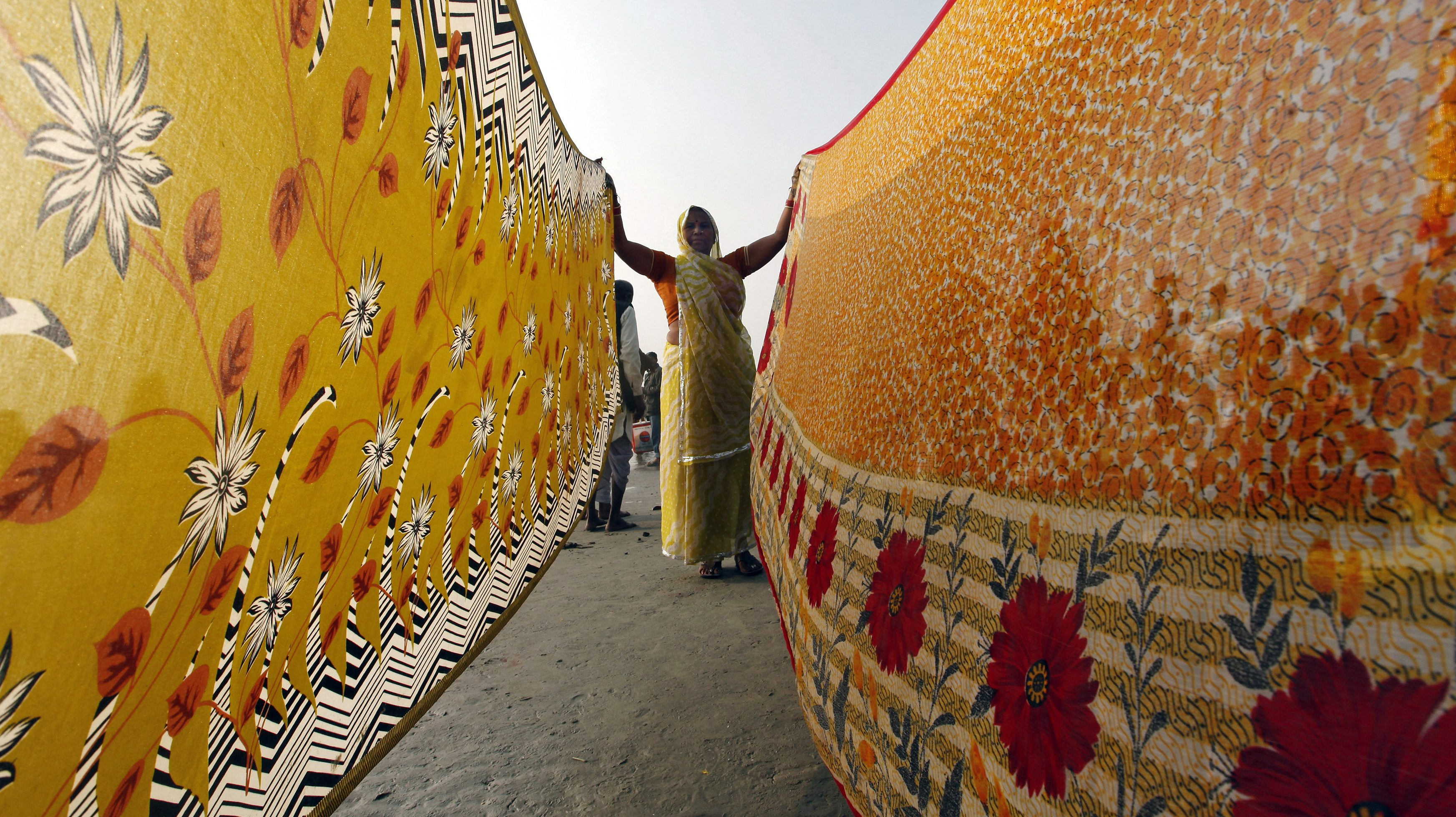 A female Hindu pilgrim dries sarees after taking a dip at the confluence of the Ganges river and the Bay of Bengal at Sagar Island, south of Kolkata.