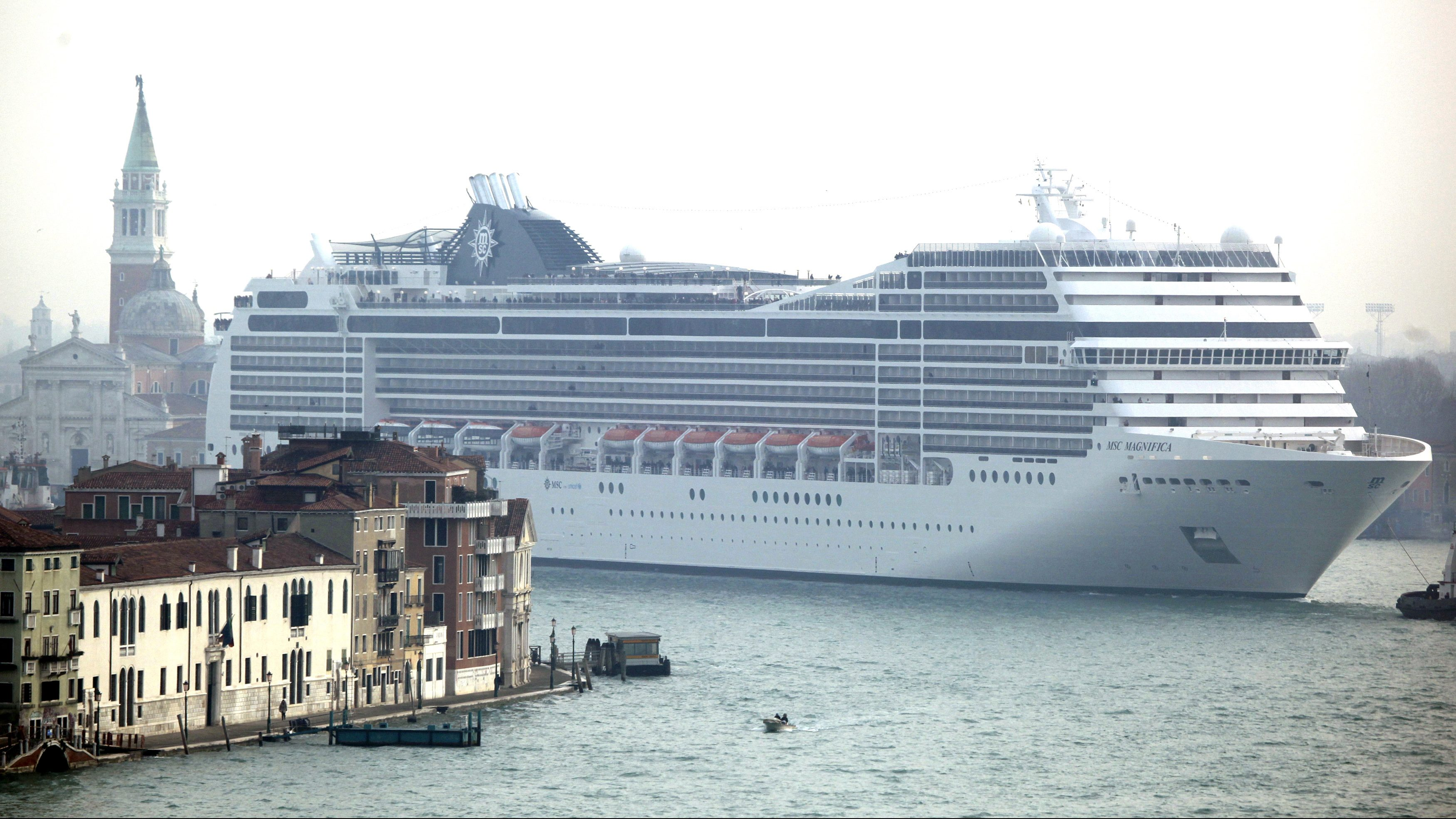 A cruise ship sails in the Venice lagoon near St. Mark's Square January 23, 2012. In the wake of the Costa Concordia disaster, Italian environmentalists and some politicians are demanding that big cruise ships be banned from passing too close to islands or shorelines, or entering delicate areas such as the Venice lagoon.