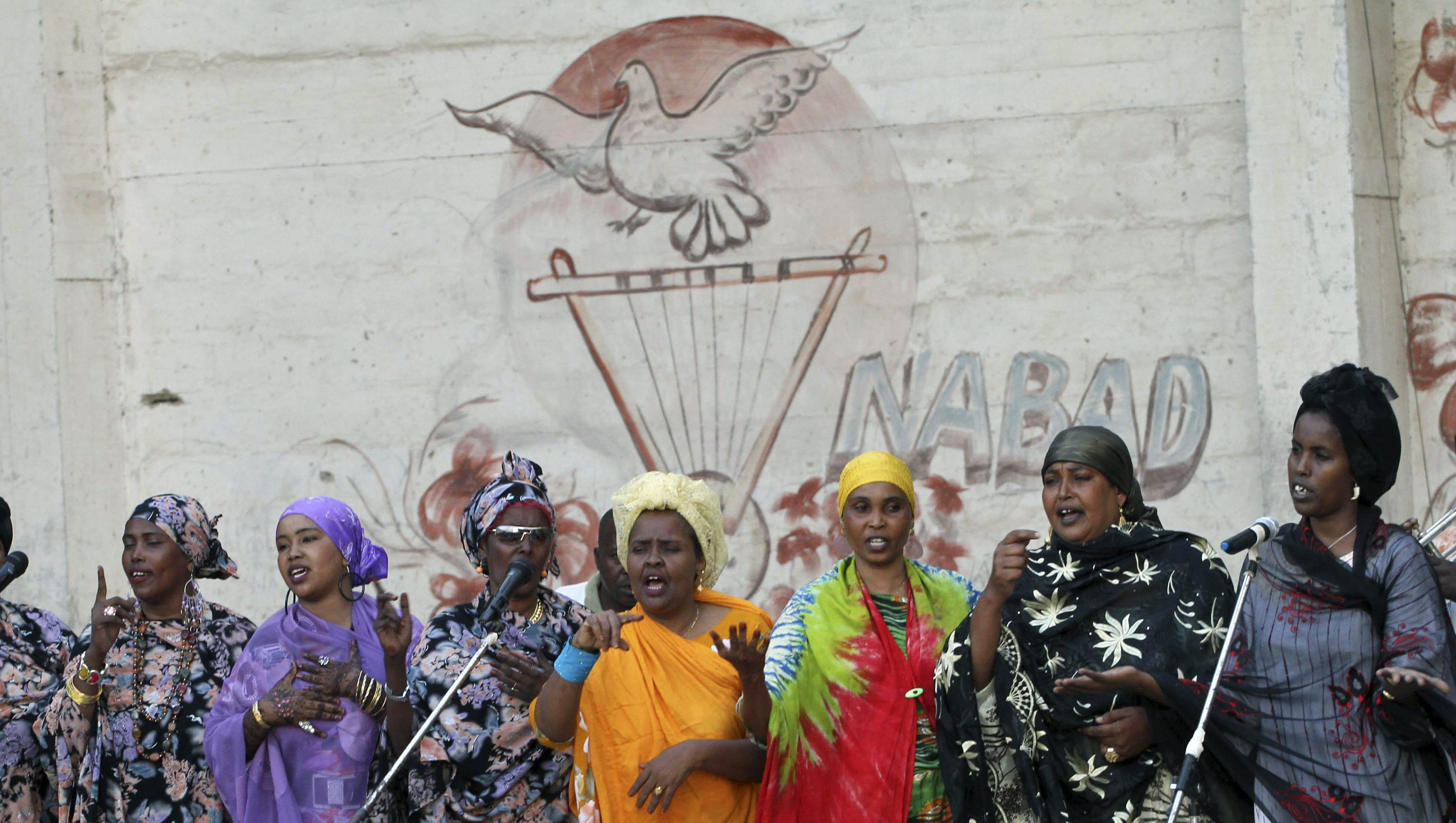 Somali national singers perform inside the National Theatre in Somalia's capital Mogadishu, March 19, 2012. In the roofless, bullet-ridden building that houses Mogadishu's National Theatre, Somali musicians staged a concert for the first time in 20 years, a sign of a marked improvement in security in the war-ravaged Horn of Africa country. Picture taken March 19, 2012.