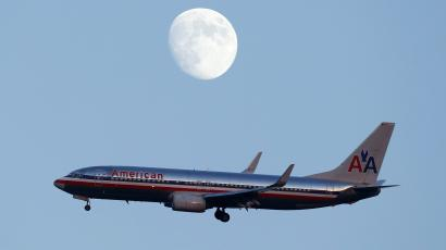 An American Airlines passenger jet comes in the land at LaGuardia airport in New York