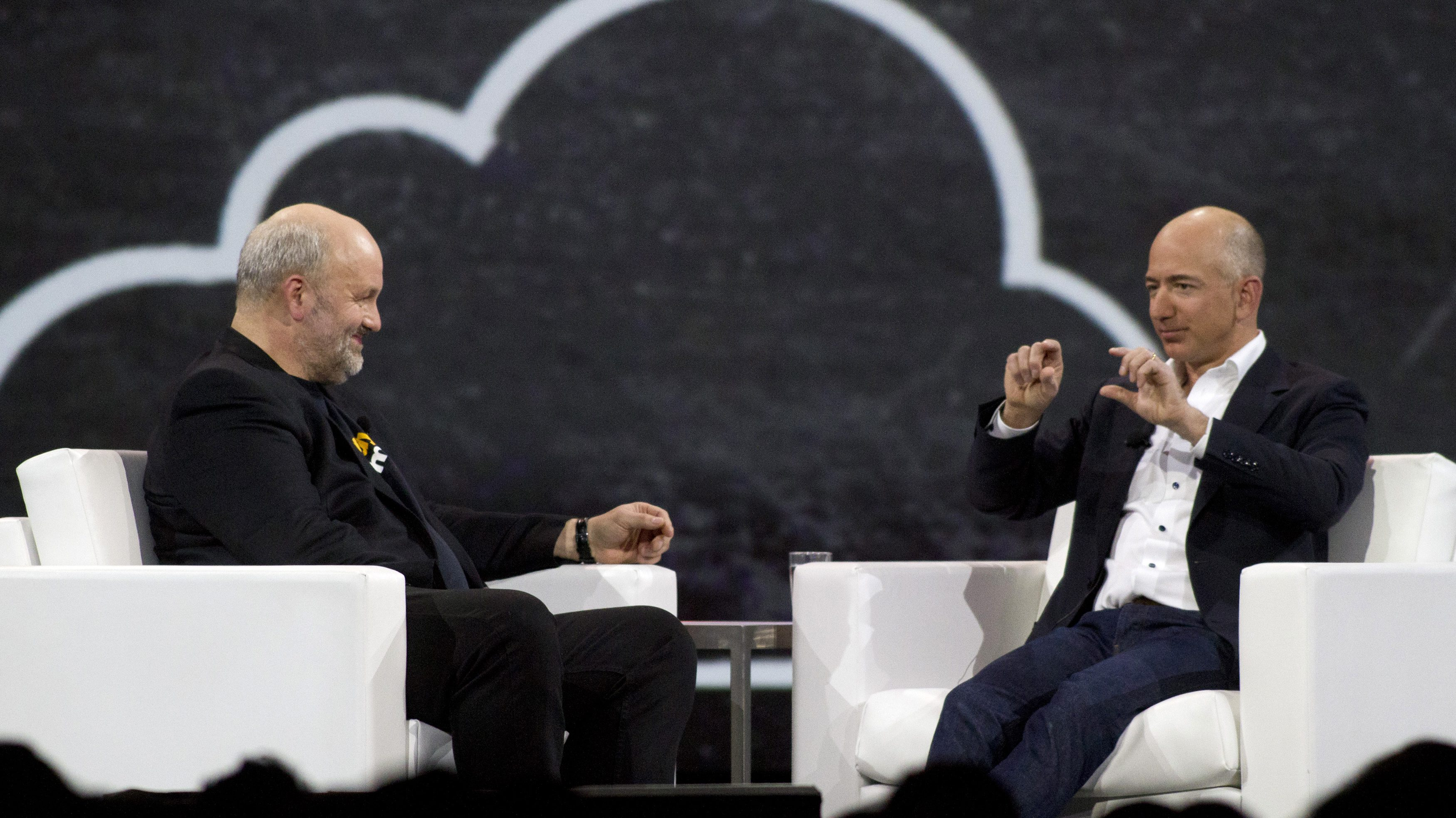 Amazon.com Chief Technology Officer Werner Vogels (L) speaks with Amazon.com Chief Executive Officer Jeff Bezos during a keynote speech at the AWS Re:Invent conference at the Sands Expo in Las Vegas, Nevada November 29, 2012. REUTERS/Richard Brian (UNITED STATES - Tags: SCIENCE TECHNOLOGY BUSINESS) - GM1E8BU0NKB01