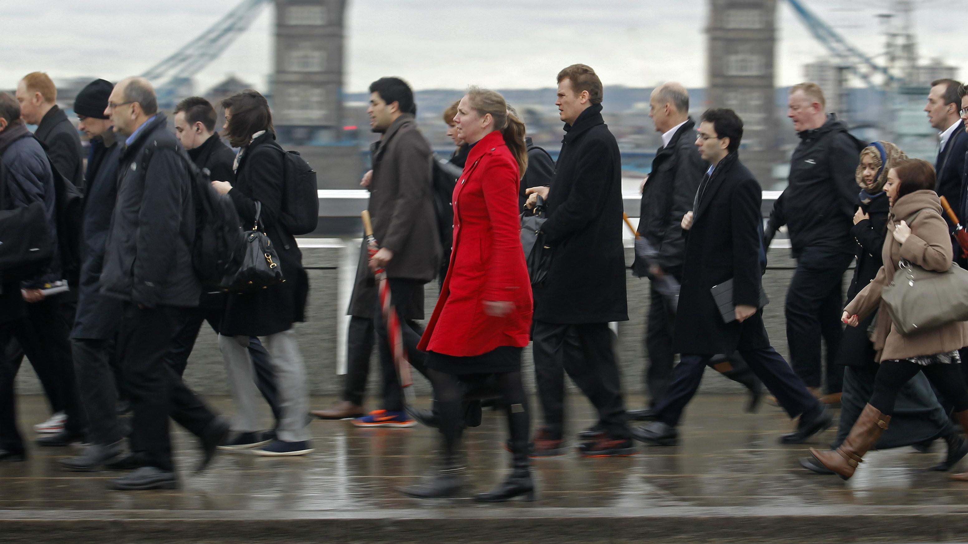 Commuters crossing London Bridge on way to work.