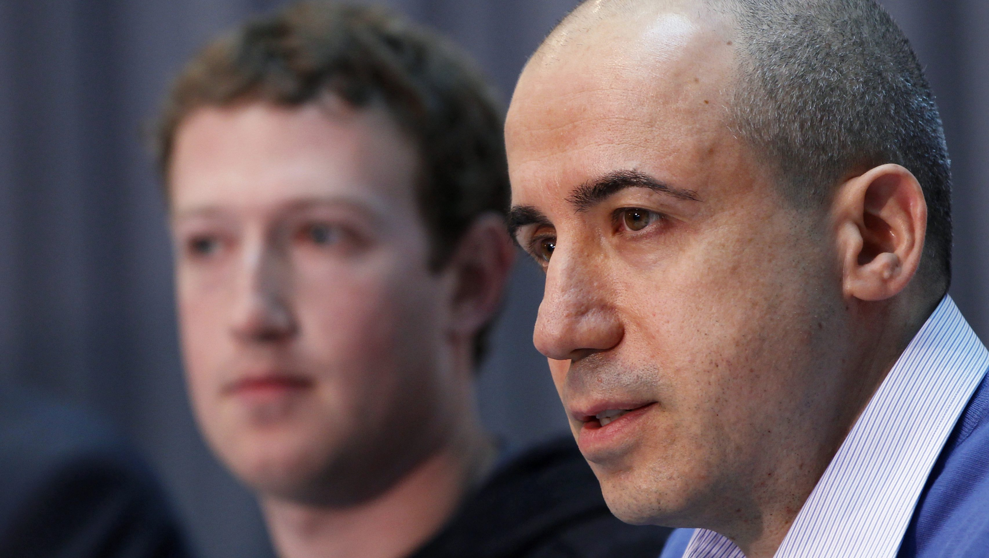 Russian entrepreneur and venture capitalist Yuri Milner (R) speaks while Facebook CEO Mark Zuckerberg looks on at the Life Sciences Breakthrough Prize announcement in San Francisco, California February 20, 2013. Eleven winners of the inaugural award each received $3 million and were recognized for excellence in research aimed at curing intractable diseases and extending human life. REUTERS/Robert Galbraith  (UNITED STATES - Tags: SCIENCE TECHNOLOGY BUSINESS) - GM1E92L0DZP01