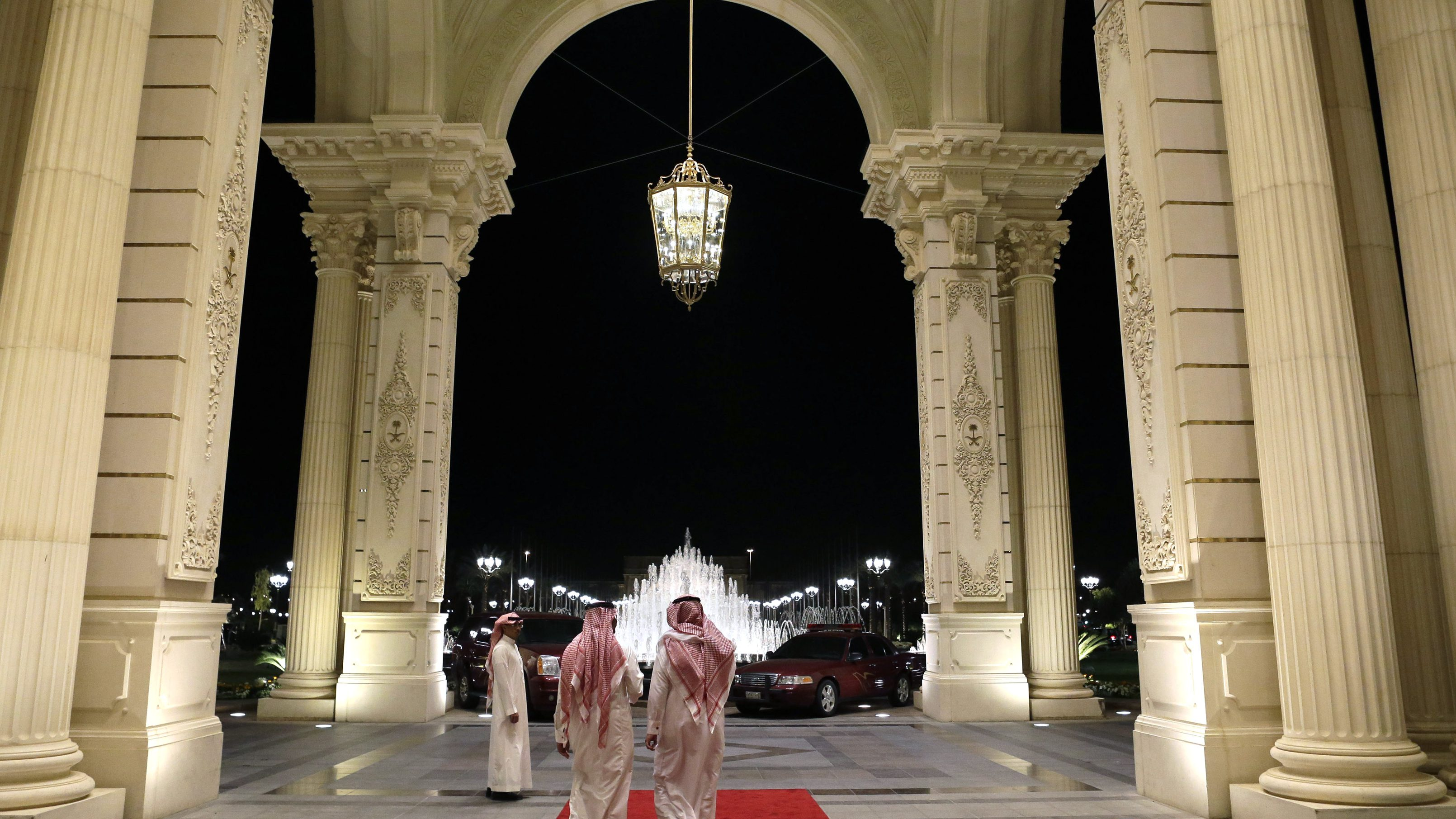 Saudi men walk at the entrance to the Ritz-Carlton Hotel, where U.S. Secretary of State John Kerry is staying in Riyadh March 4, 2013.  REUTERS/Jacquelyn Martin/Pool (SAUDI ARABIA - Tags: POLITICS) - GM1E9341NPU01