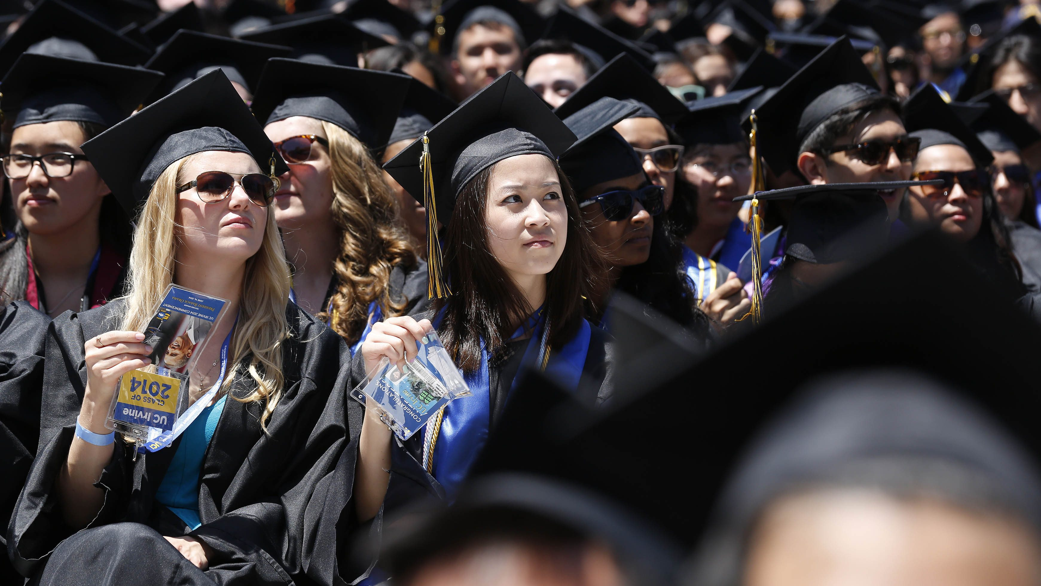 Graduates listen to U.S. President Obama talk during the commencement ceremony for the University of California, Irvine in Anaheim