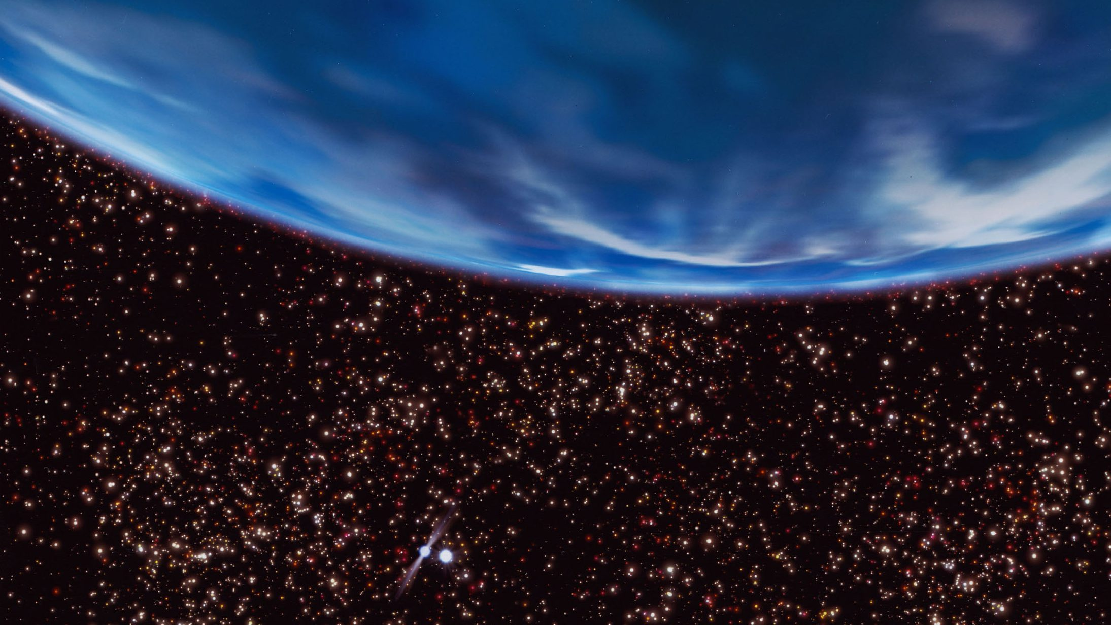 A rich starry sky fills the view from an ancient gas-giant planet in the core of the globular star cluster M4, as imagined in this artist's concept. The 13-billion-year-old planet orbits a helium white-dwarf star and the millisecond pulsar B1620-26, seen at lower left.