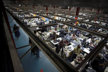 Employees work on the manufacturing line at a textile factory in Nairobi, Kenya.