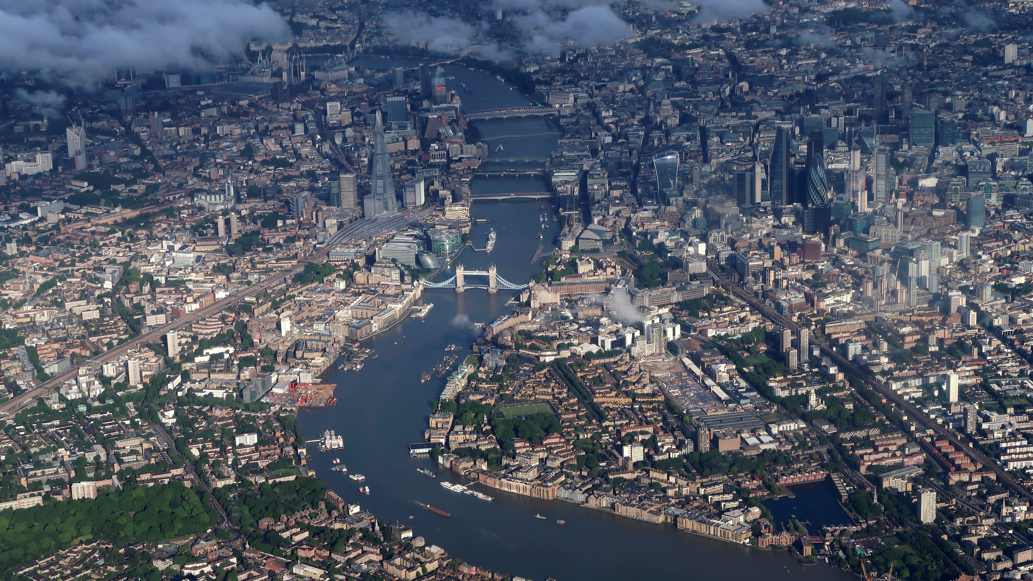 The Tower Bridge and the city centre are pictured in an aerial view, in London, Britain, July 30, 2017.