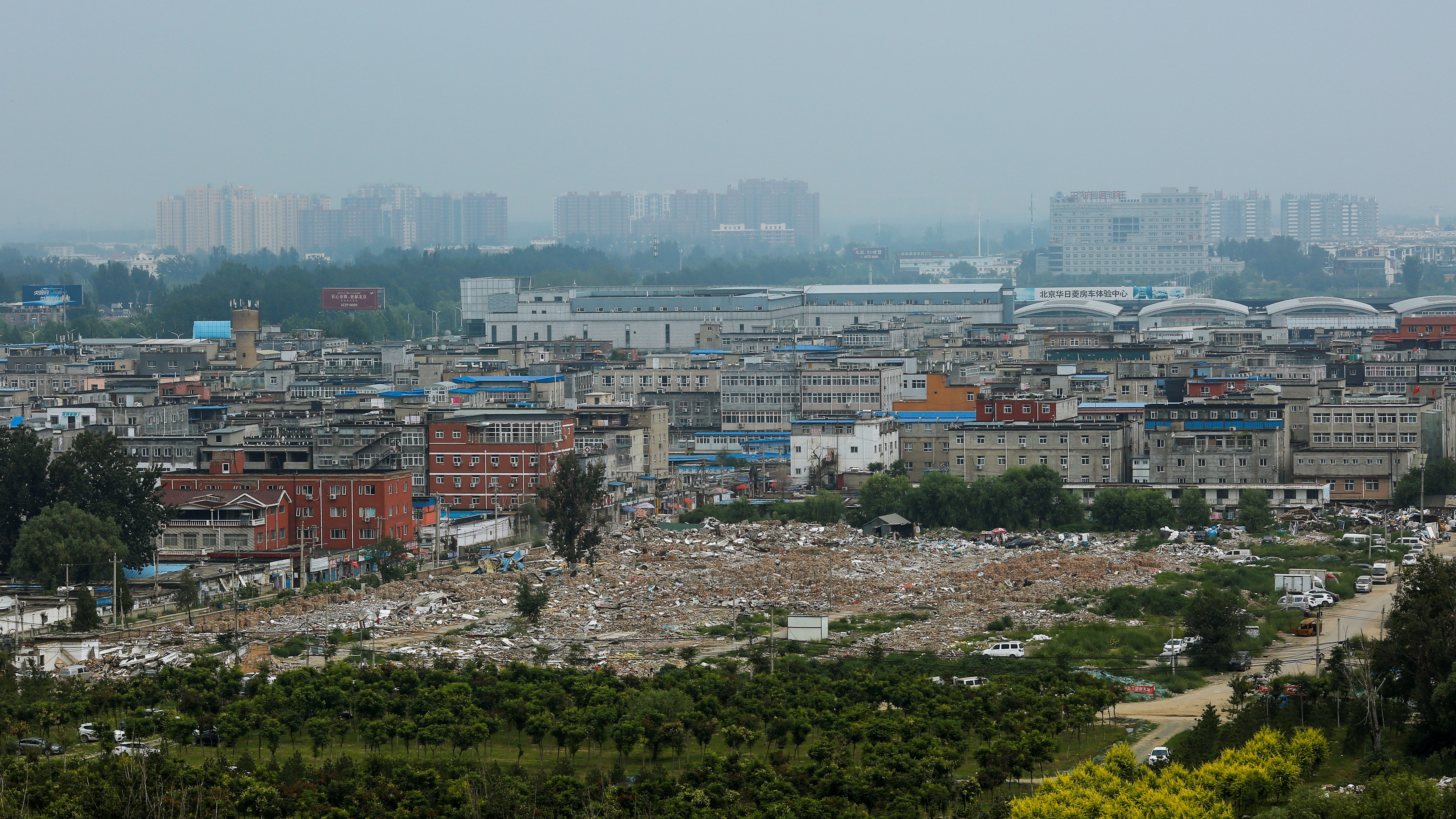 Debris covers the ground where former migrant dwellings used to stand at the outskirts of Beijing, China, August 8, 2017.  Picture taken August 8, 2017.  REUTERS/Thomas Peter - RC1F111C1420