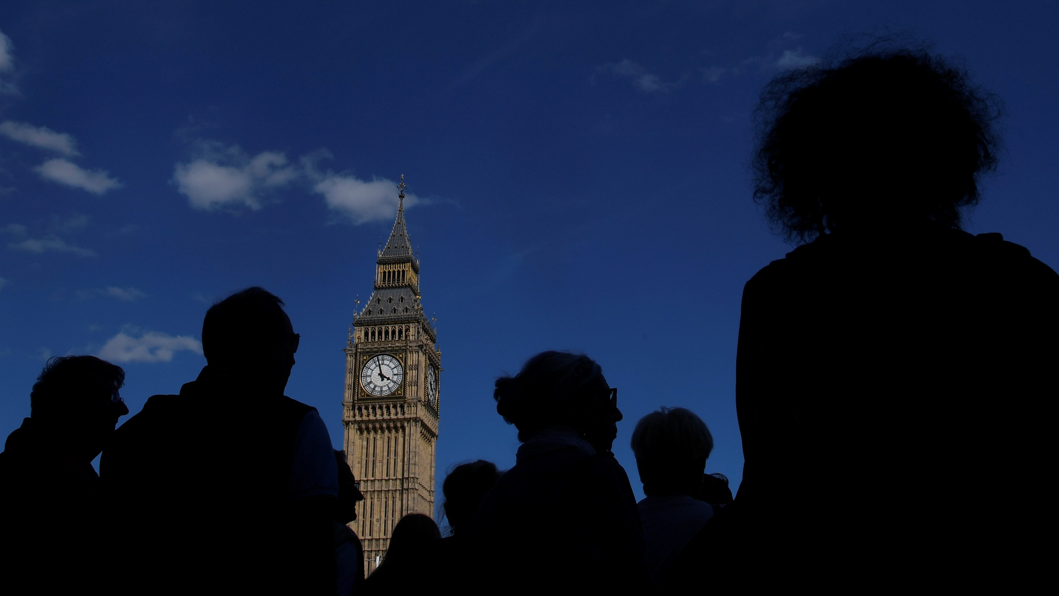 Tourists view the Elizabeth Tower, which houses the Great Clock and the 'Big Ben' bell, at the Houses of Parliament, in central London, Britain, August 16, 2017.