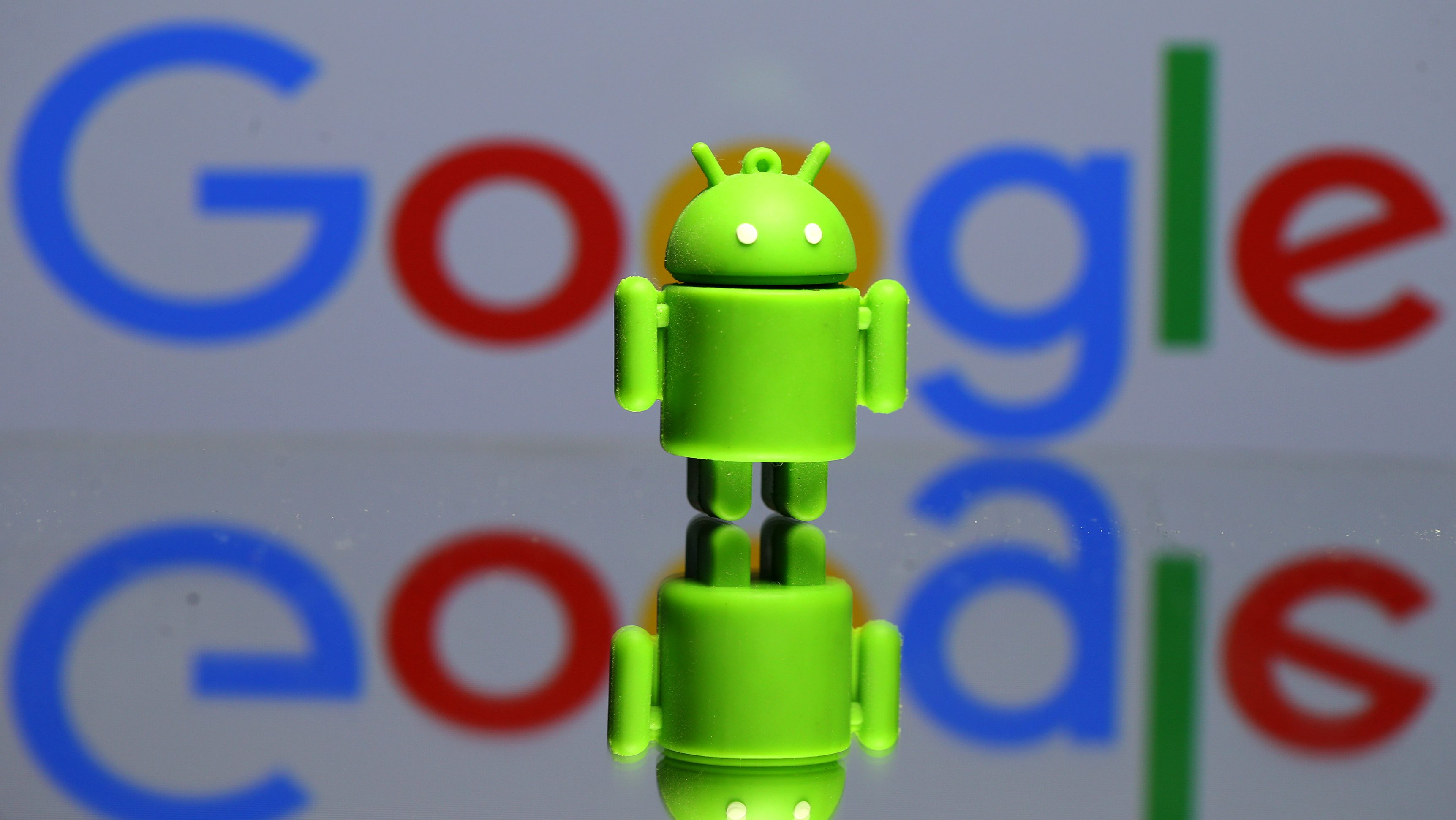 A 3D printed Android mascot Bugdroid is seen in front of a Google logo in this illustration taken July 9, 2017. Picture taken July 9, 2017.  REUTERS/Dado Ruvic/Illustration - RC13A81B4A00