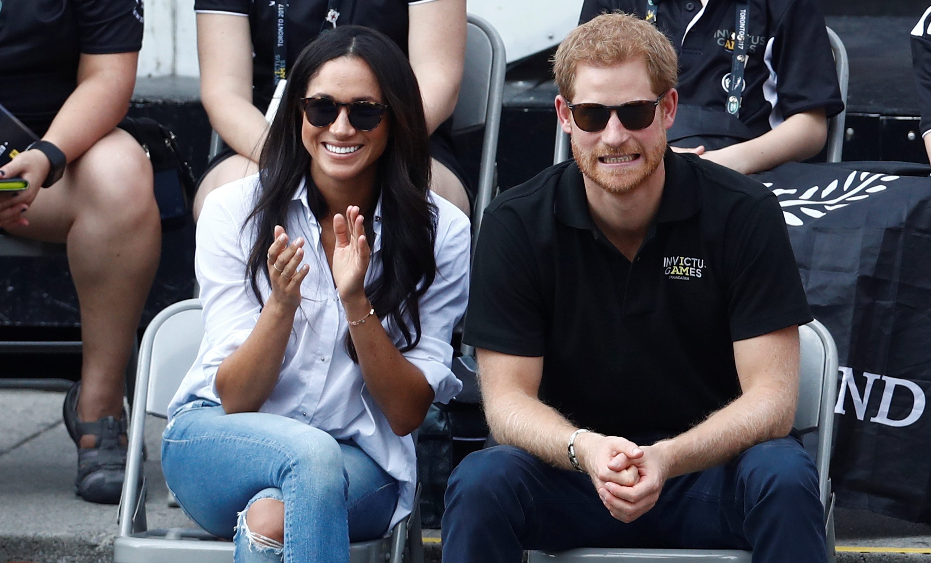 Britain's Prince Harry and his girlfriend actress Meghan Markle watch the wheelchair tennis event during the Invictus Games in Toronto, Ontario, Canada September 25, 2017. REUTERS/Mark Blinch - RC1C33DB3580