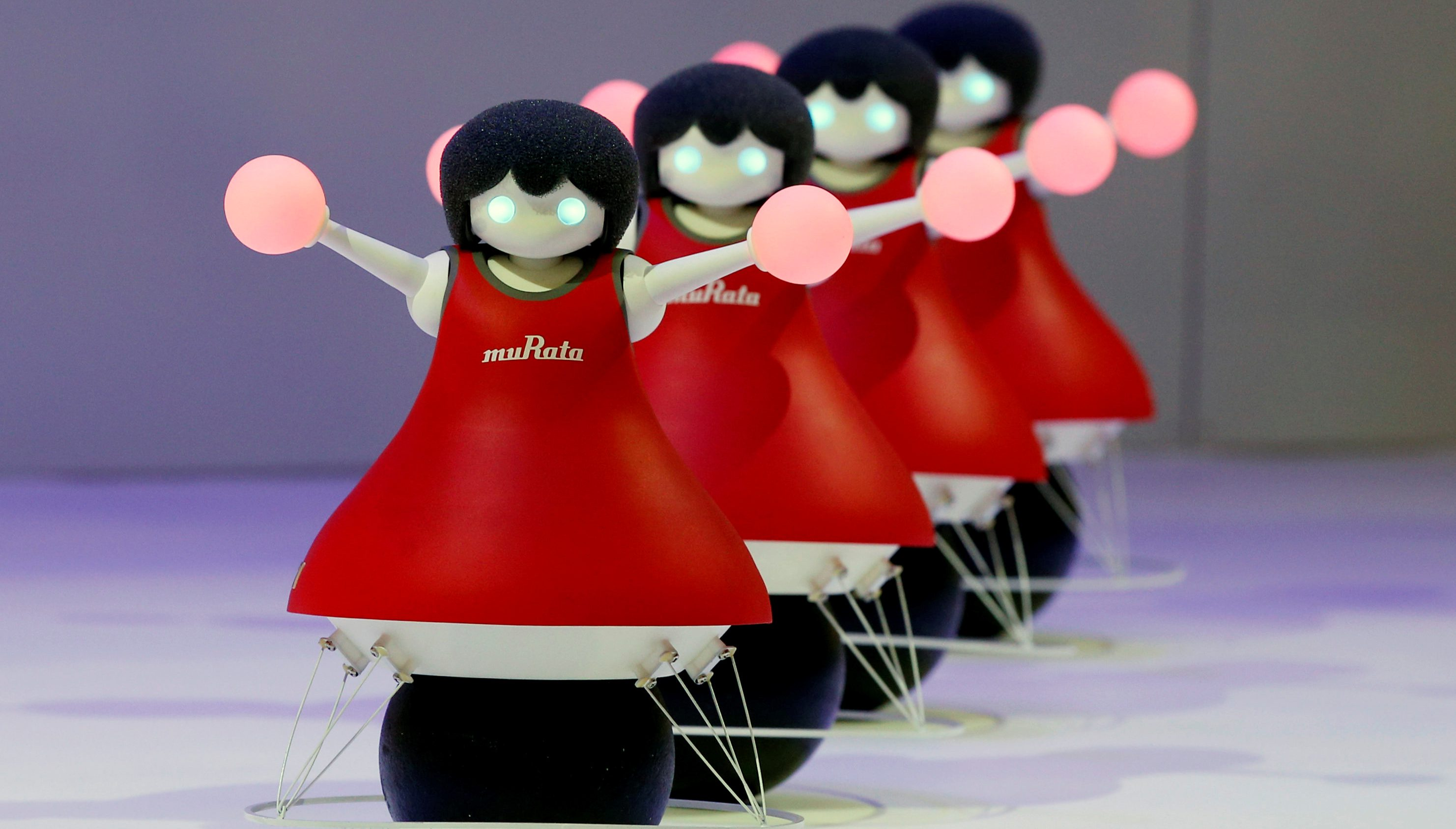 "Murata Manufacturing Co. Ltd's concept robots, the ""Murata Cheerleaders"", demonstrate how they balance on balls and synchronise as a team by utilising sensing and communication technology, at CEATEC (Combined Exhibition of Advanced Technologies) JAPAN 2017 at the Makuhari Messe in Chiba, Japan October 2, 2017."