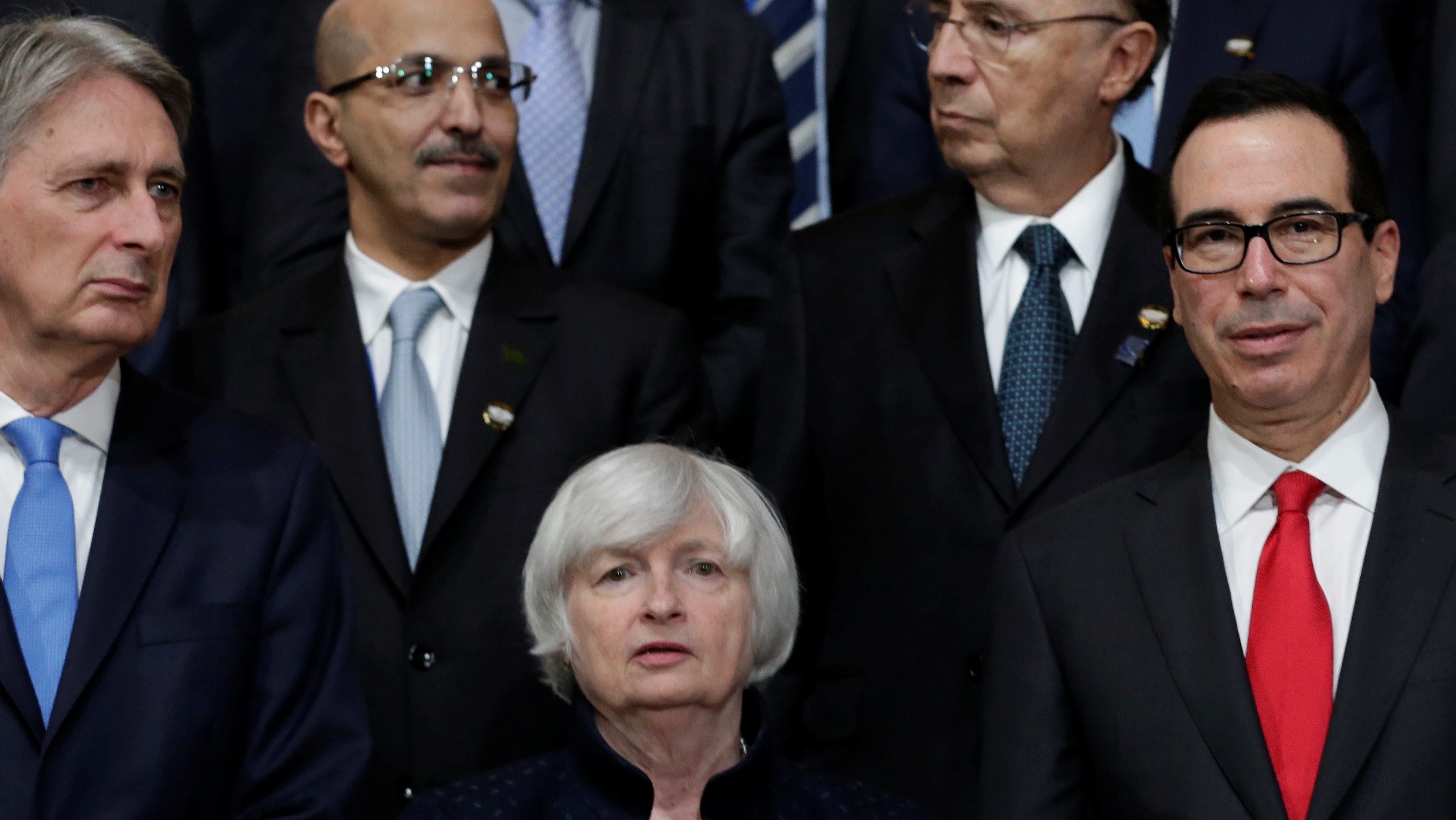 Britain's Chancellor of the Exchequer, Philip Hammond, Federal Reserve Chair Janet Yellen and U.S. Treasury Secretary Steve Mnuchin pose