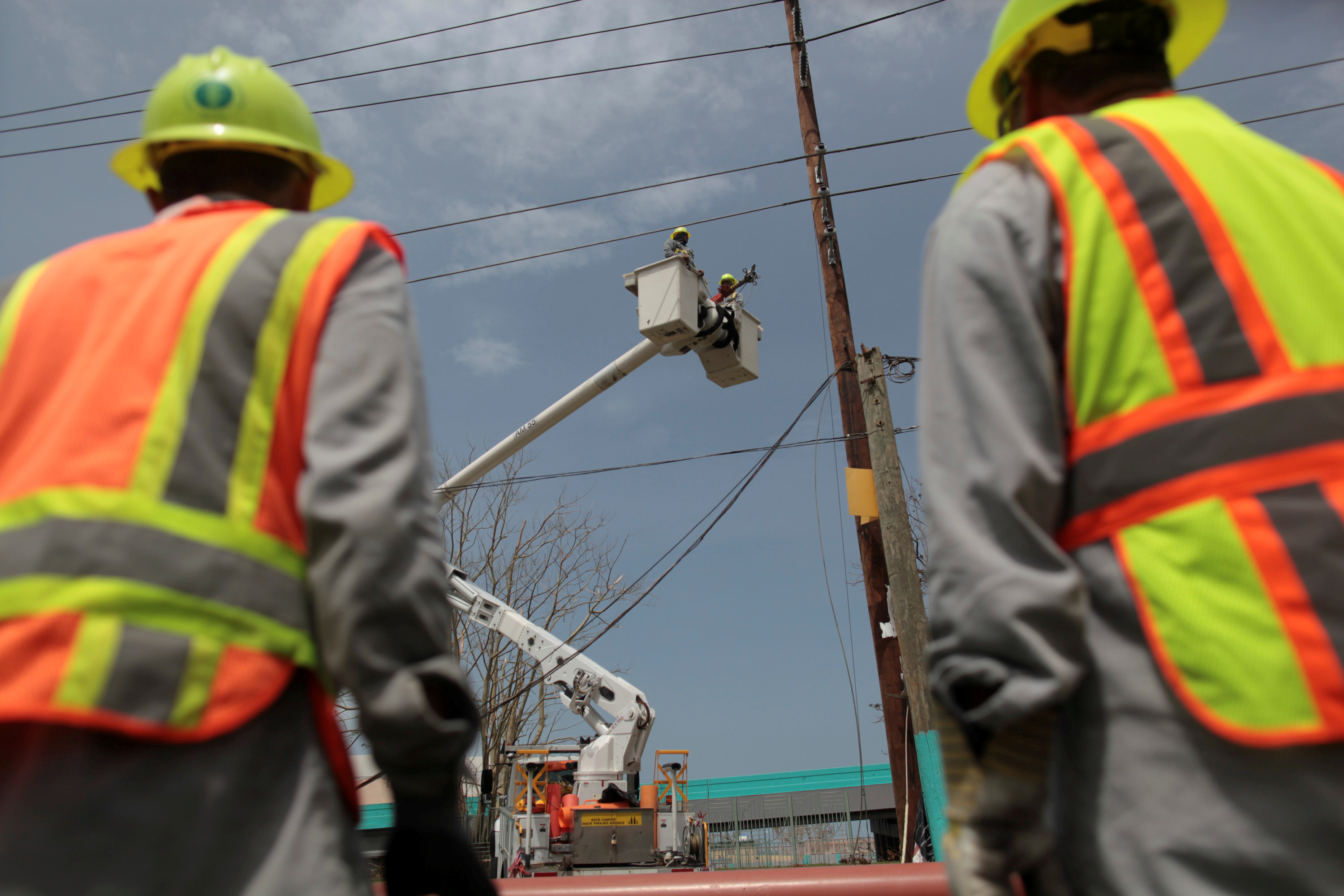 FILE PHOTO: Workers repairs electrical installations after the area was hit by Hurricane Maria in San Juan