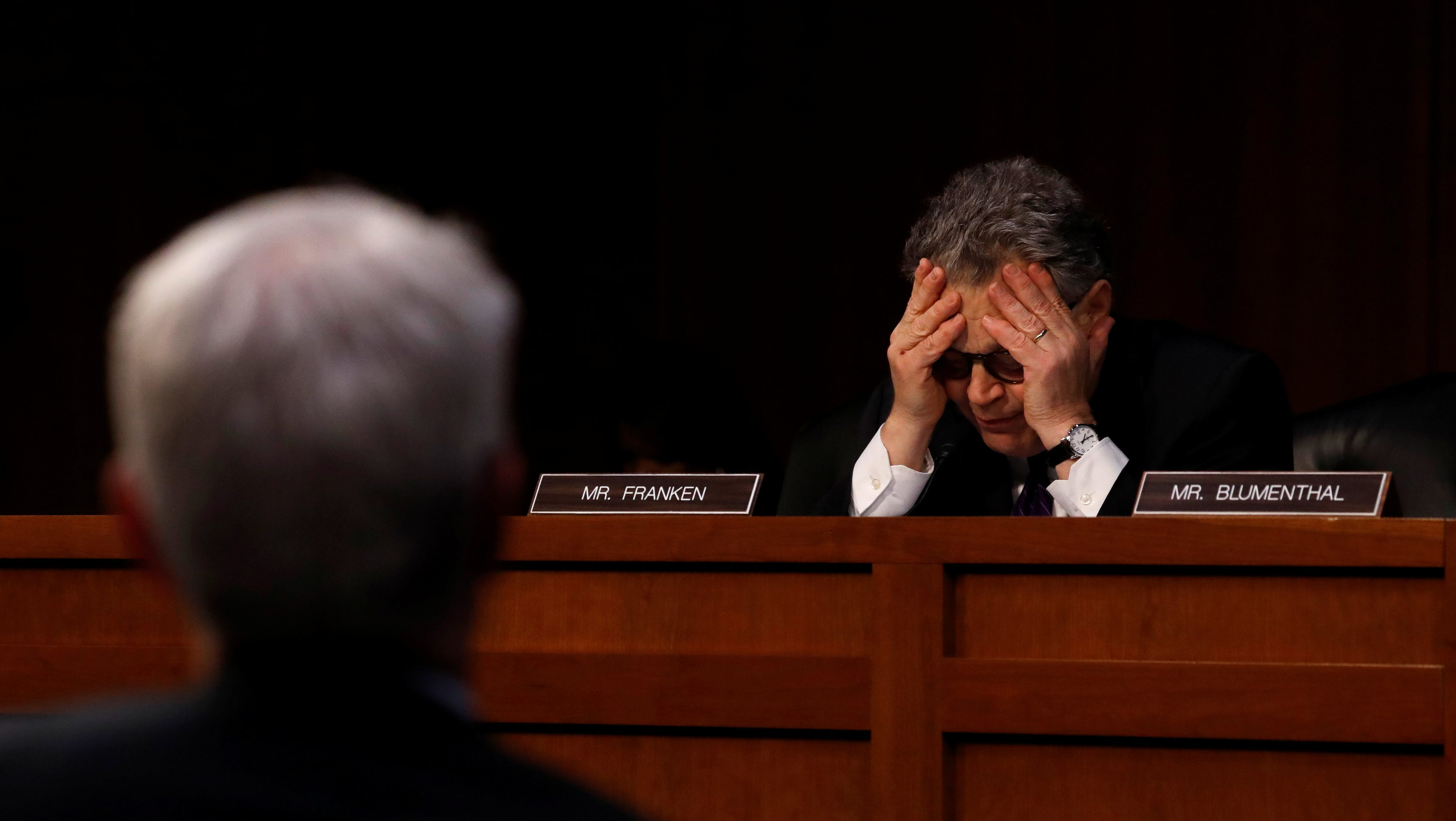 U.S. Senator Al Franken buries his head in his hands after an exchange with Facebook General Counsel Colin Stretch as he testifies before a Senate Judiciary Crime and Terrorism Subcommittee hearing on how Russia allegedly used their services to try to sway the 2016 U.S. elections, on Capitol Hill in Washington, U.S., October 31, 2017. REUTERS/Jonathan Ernst - RC1F6F3DB760