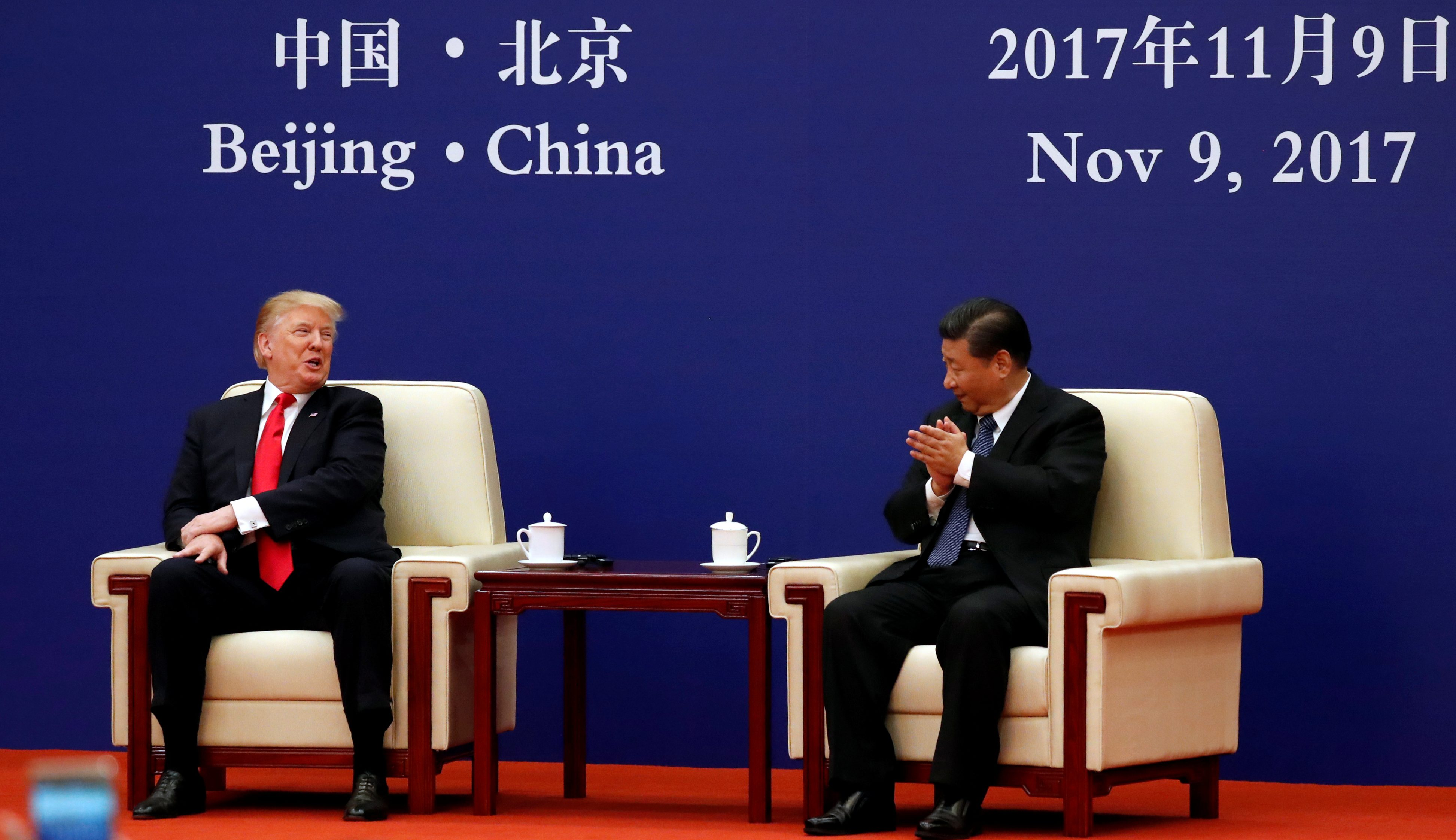 U.S. President Donald Trump and China's President Xi Jinping meet business leaders at the Great Hall of the People in Beijing, China, November 9, 2017. REUTERS/Jonathan Ernst - RC1B066AD260