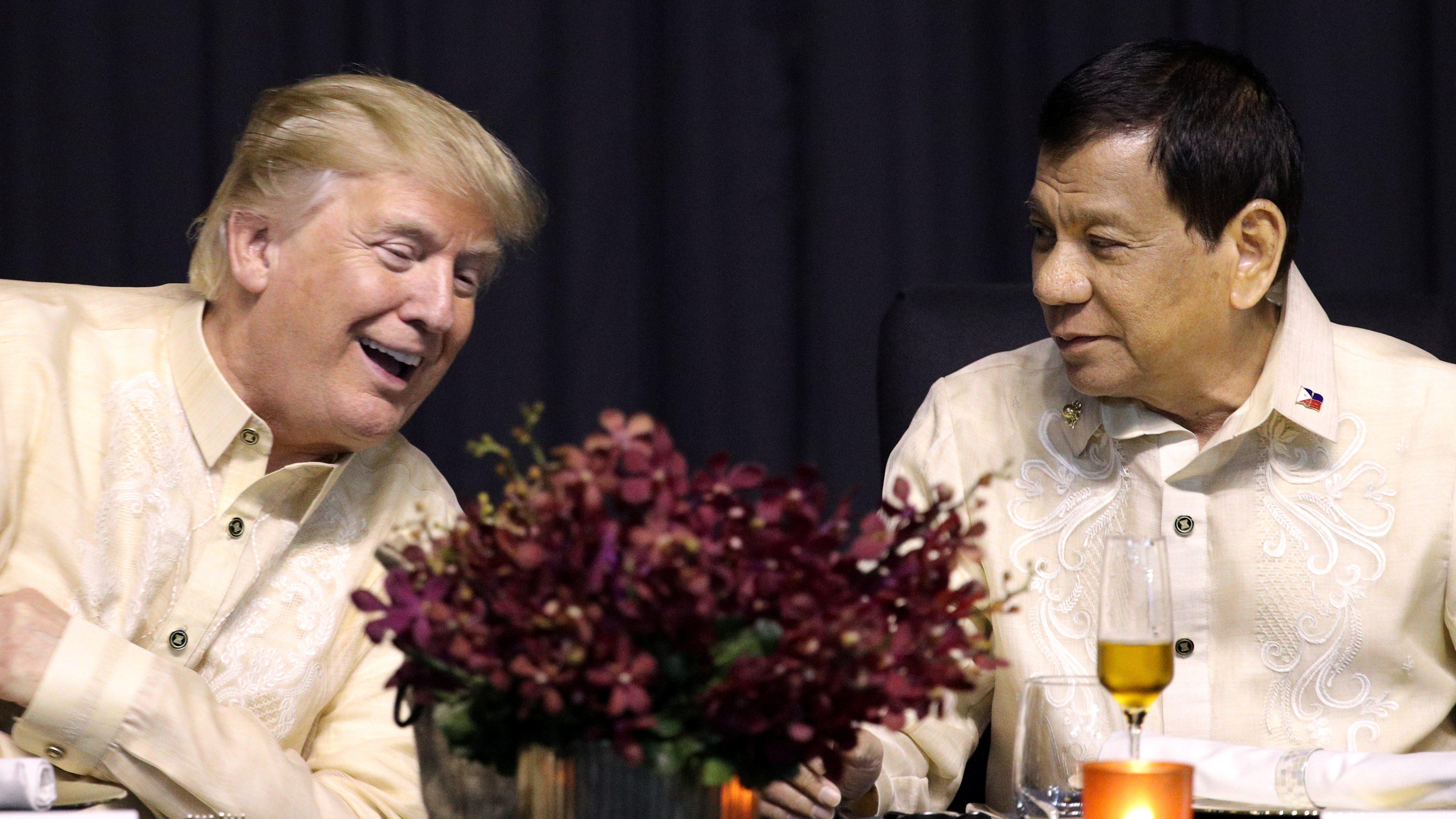 U.S. President Donald Trump speaks with Philippines President Rodrigo Duterte during the gala dinner marking ASEAN's 50th anniversary in Manila, Philippines, November 12, 2017.