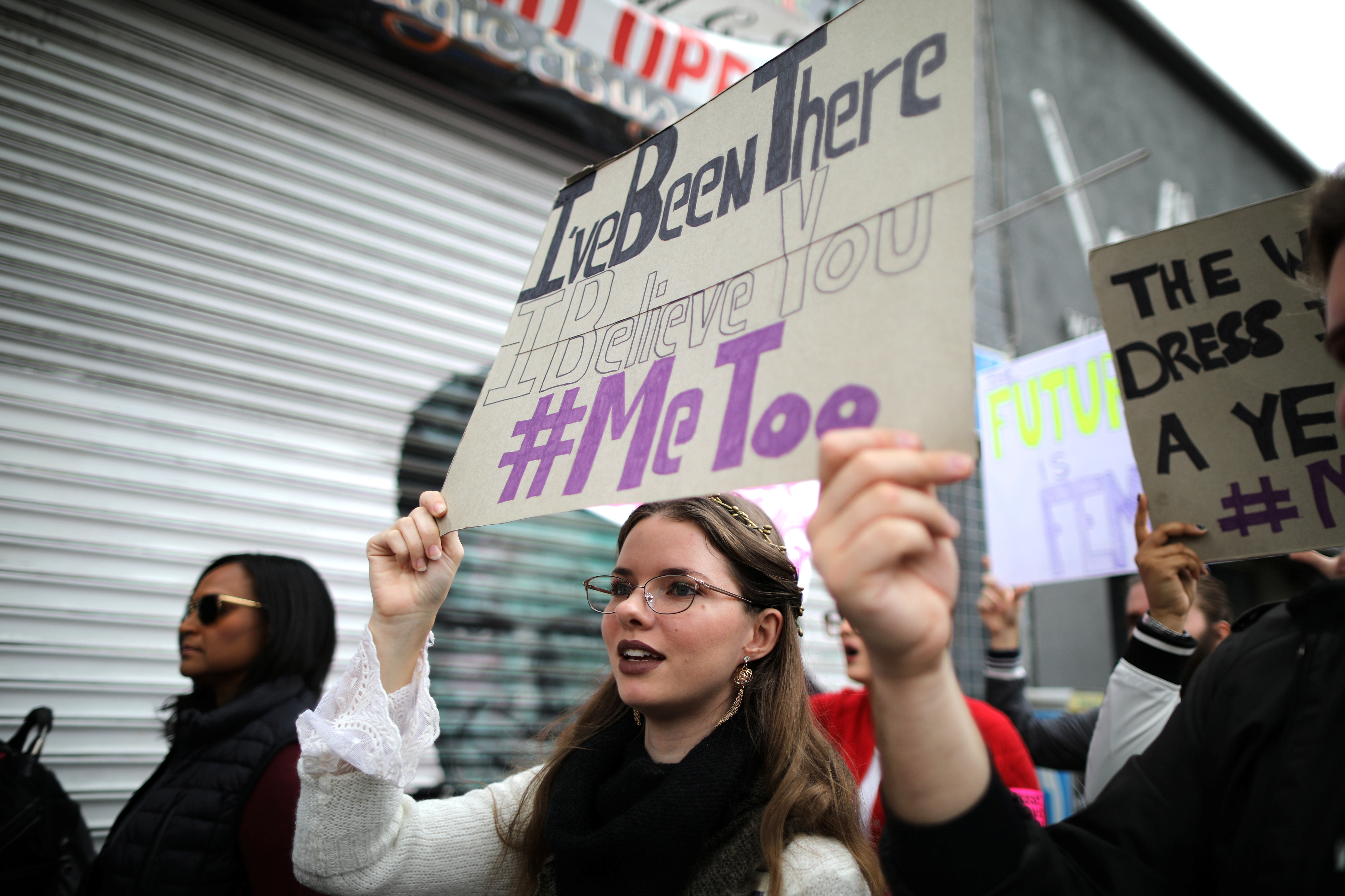 People participate in a protest march for survivors of sexual assault and their supporters in Hollywood, Los Angeles, California U.S. November 12, 2017. REUTERS/Lucy Nicholson - RC1CEFF7E260