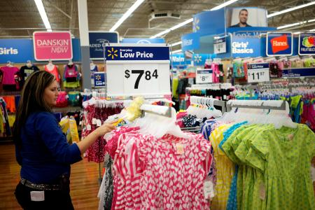 FILE PHOTO: An employee cleans a clothes rack at the Walmart Supercenter in Bentonville, Arkansas, U.S., June 5, 2014. REUTERS/Rick Wilking/File Photo GLOBAL BUSINESS WEEK AHEAD SEARCH GLOBAL BUSINESS 13 NOV FOR ALL IMAGES - RC11ED7FA960