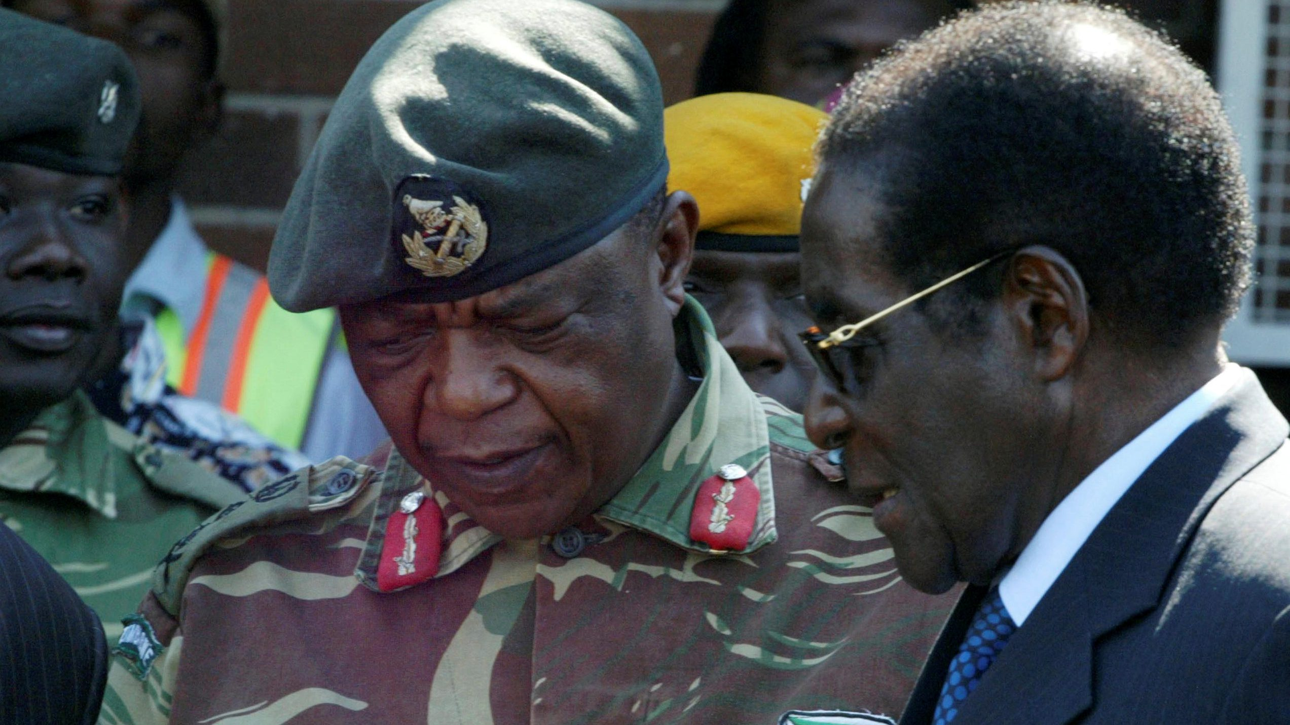 FILE PHOTO: President Robert Mugabe talks to General Constantino Chiwenga in Harare, Zimbabwe