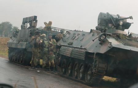 Photos: These images from Zimbabwe's streets show the military might that is in control now