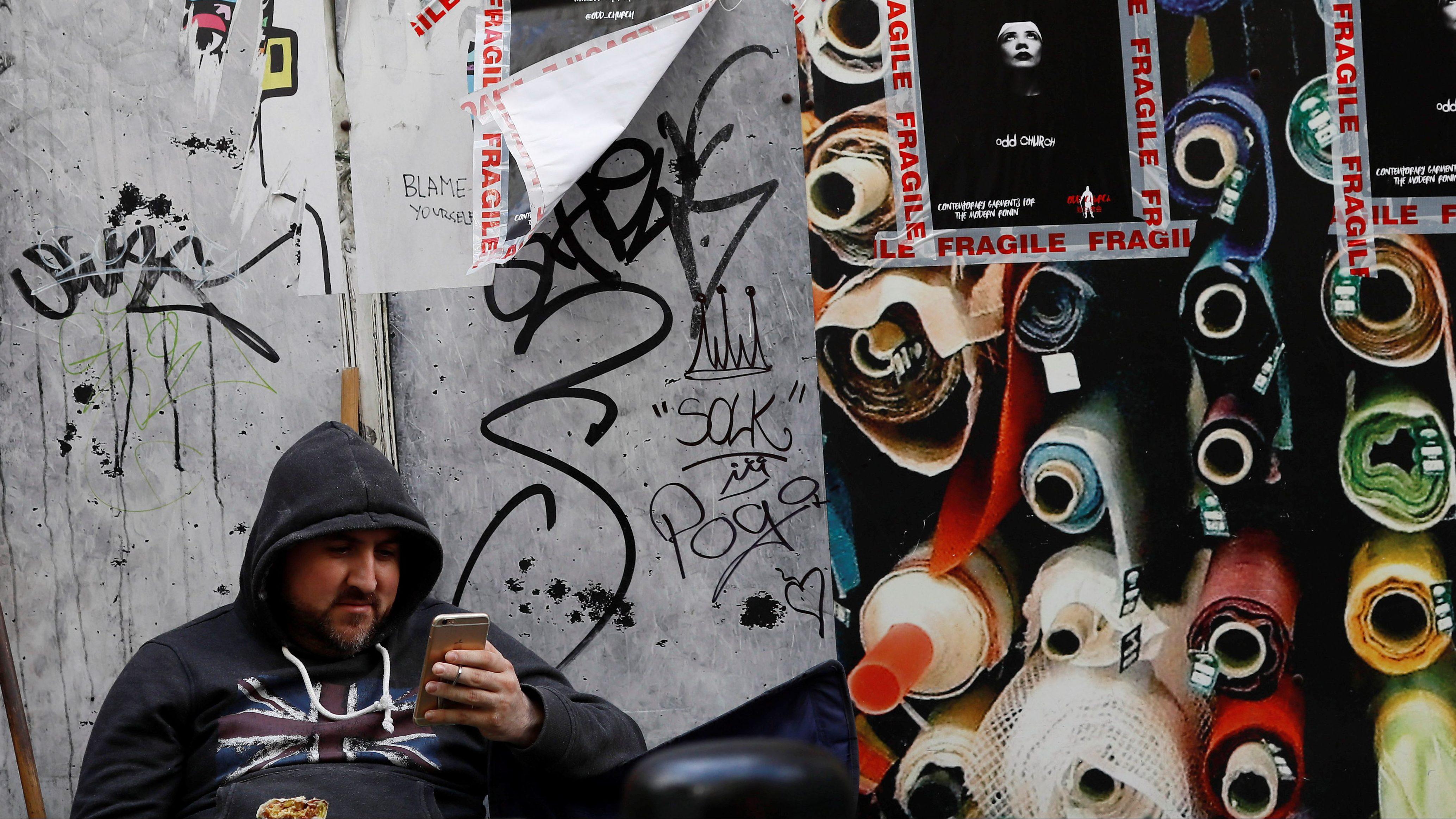 man looking at phone instagram poetry