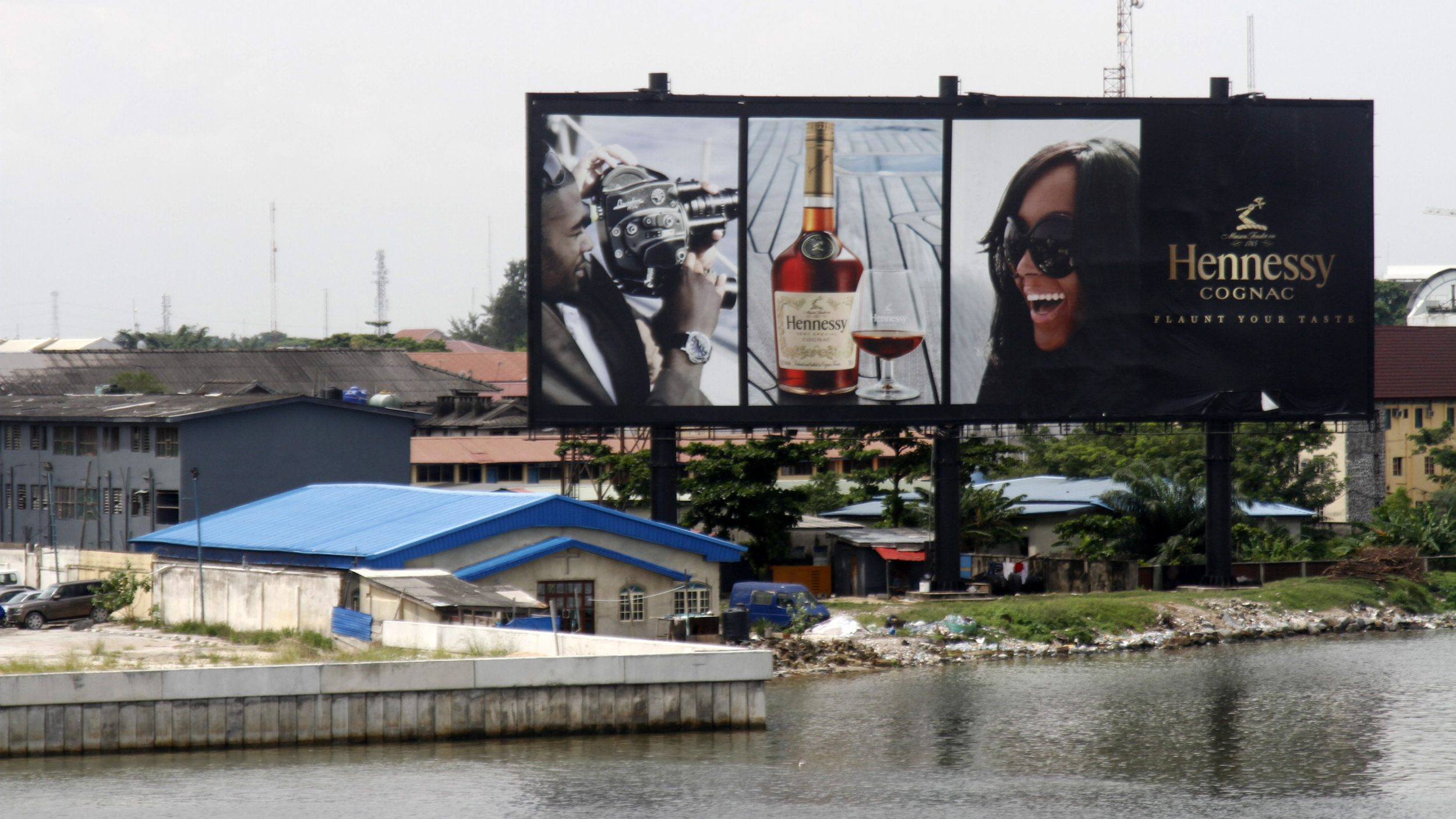 A billboard advertising Hennessy cognac is pictured near the lagoon in Ikoyi district in Lagos