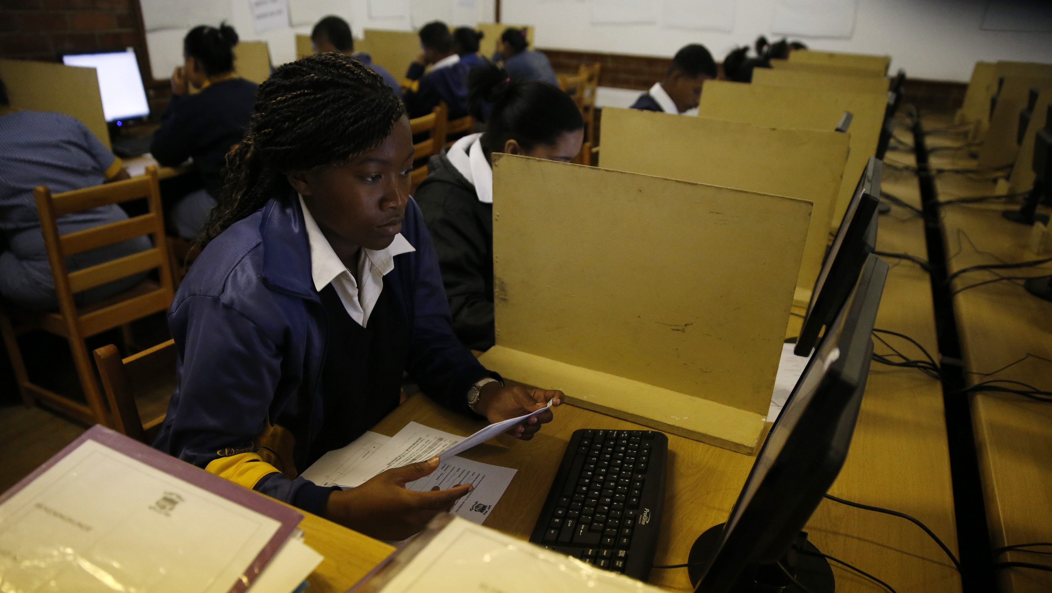 Students use computers to study at Elswood Secondary School in Cape Town
