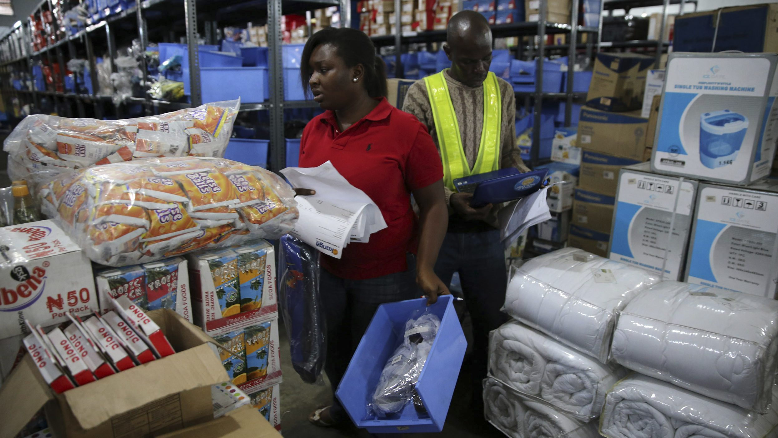 A staff members take stock of goods at the warehouse of Konga online shopping company in Ilupeju district in Nigeria's commercial capital Lagos