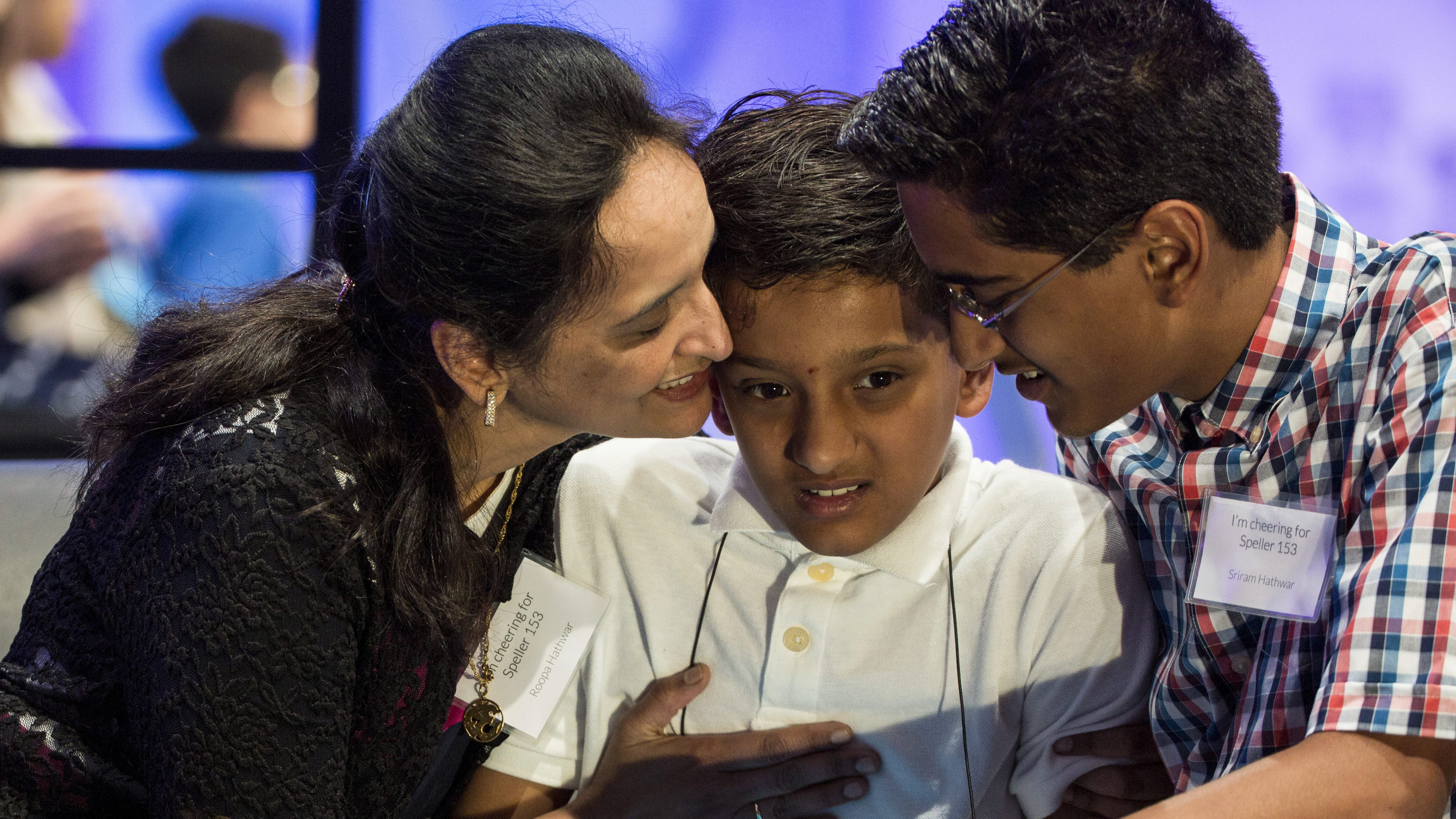 "Jairam Hathwar of Corning, New York, is comforted by his parents Roopa and Sriram after he failed to spell ""riegel"" during the semi-final round of the 88th annual Scripps National Spelling Bee"