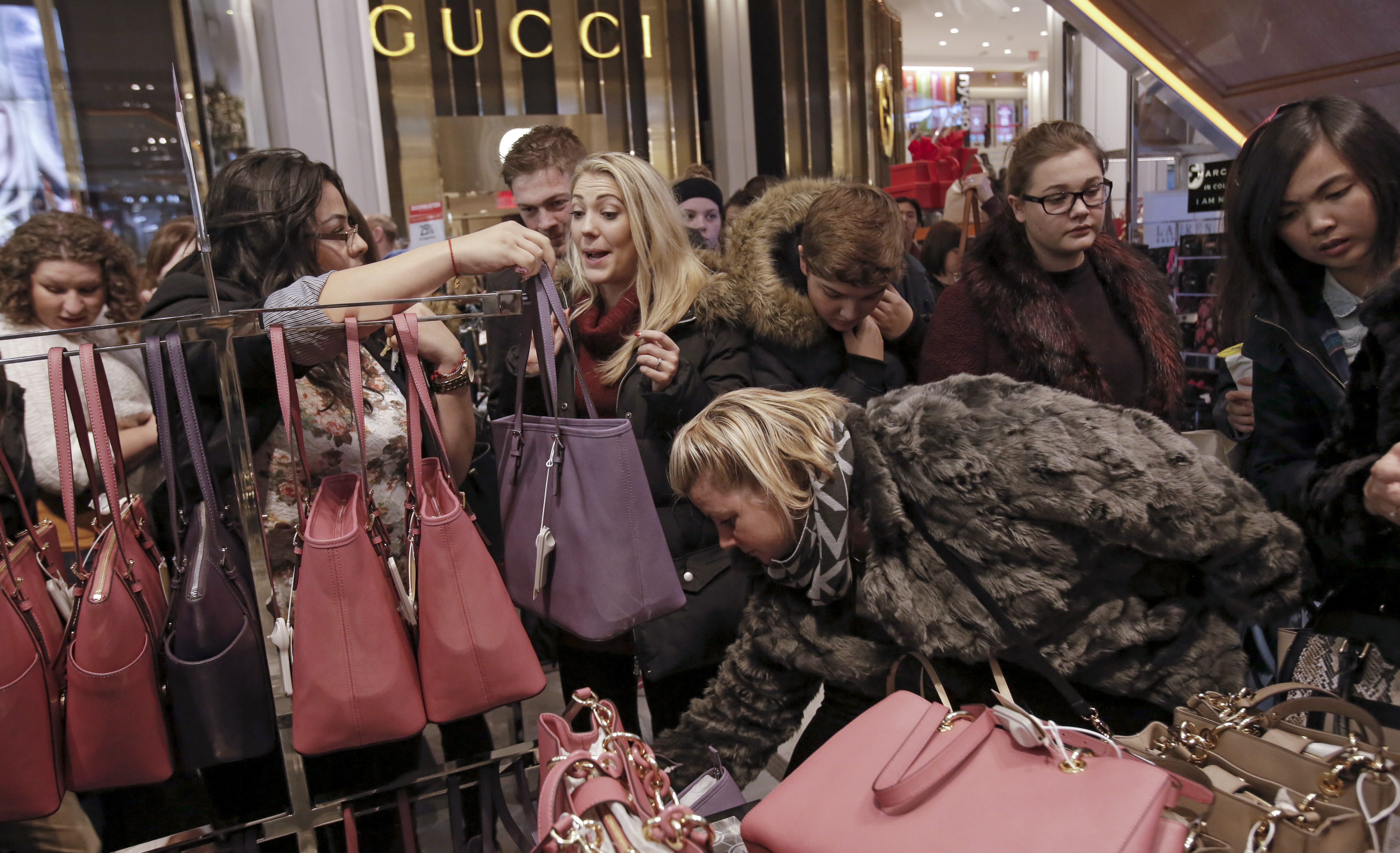 Women shop for handbags at Macy's Herald Square store during the early opening of the Black Friday sales in the Manhattan borough of New York, November 26, 2015. REUTERS/Andrew Kelly - GF20000075605