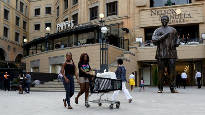 Shoppers push trolleys at an upmarket shopping mall in Sandton, Johannesburg, in this September 23, 2015 file photo.