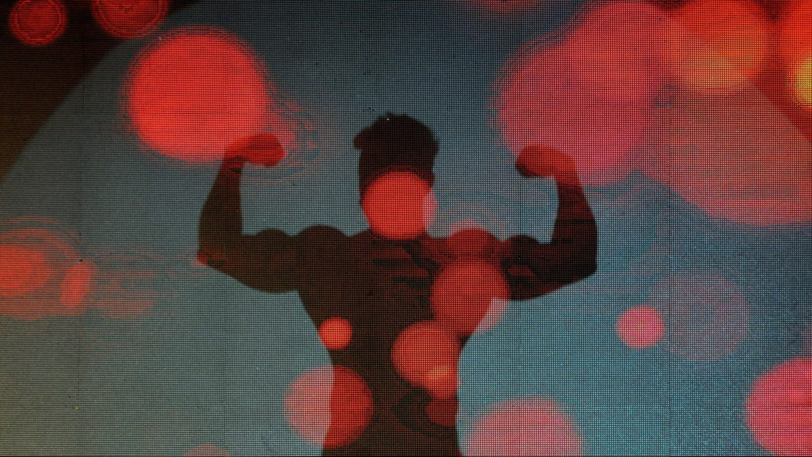 A participant casts his shadow on a screen as he flexes his muscles during a bodybuilding competition in Bengaluru, India, June 25, 2016. REUTERS/Abhishek N. Chinnappa - D1BETLYXJZAA