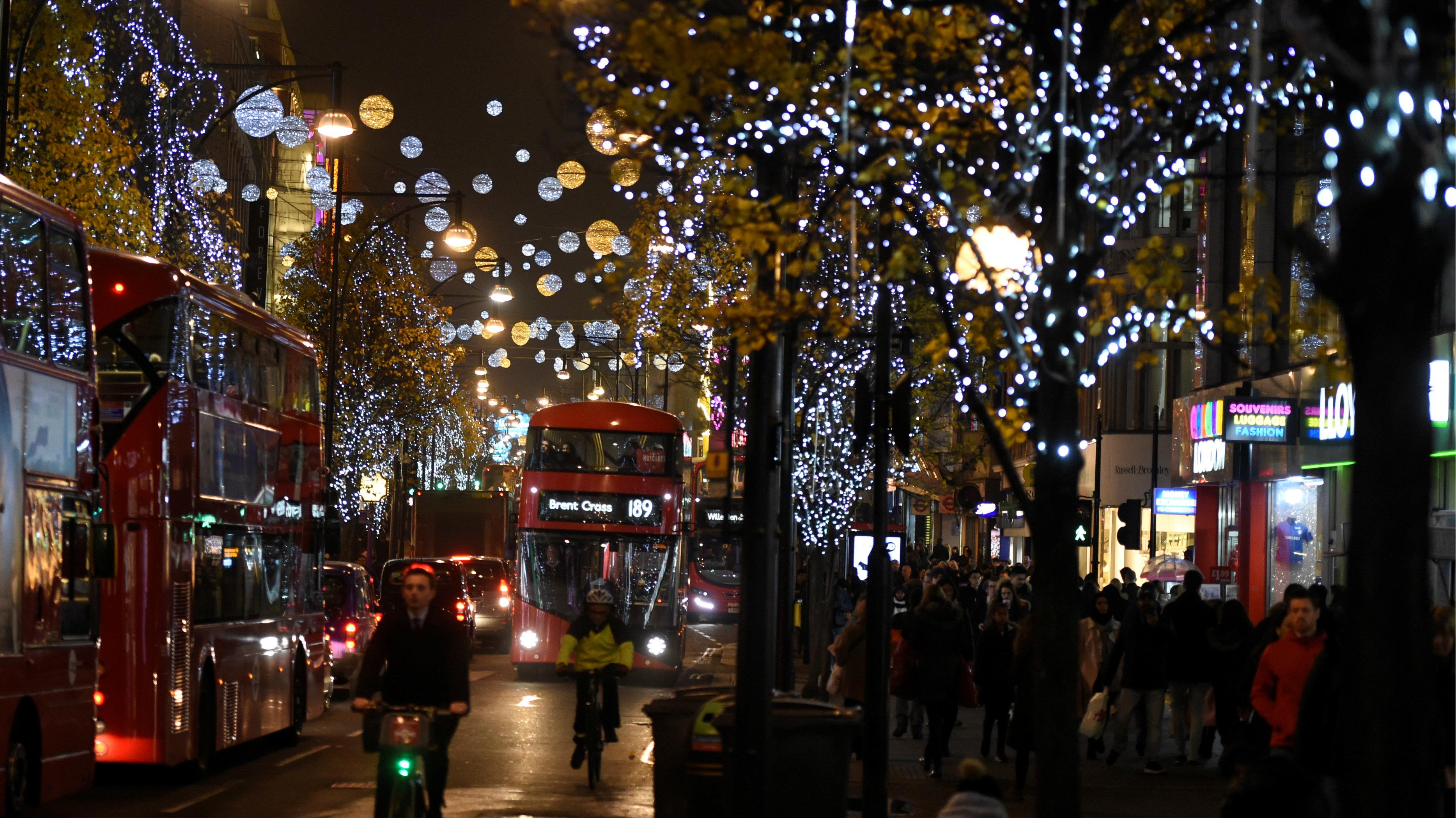 christmas lights are seen illuminated on oxford street in london