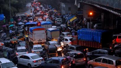 Vehicles are seen stuck in a traffic jam at an intersection after rains in Mumbai