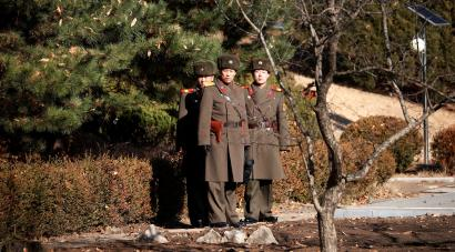 North Korean soldiers keep watch toward the south next to a spot where a North Korean has defected crossing the border on November 13, at the truce village of Panmunjom inside the demilitarized zone, South Korea, November 27, 2017.