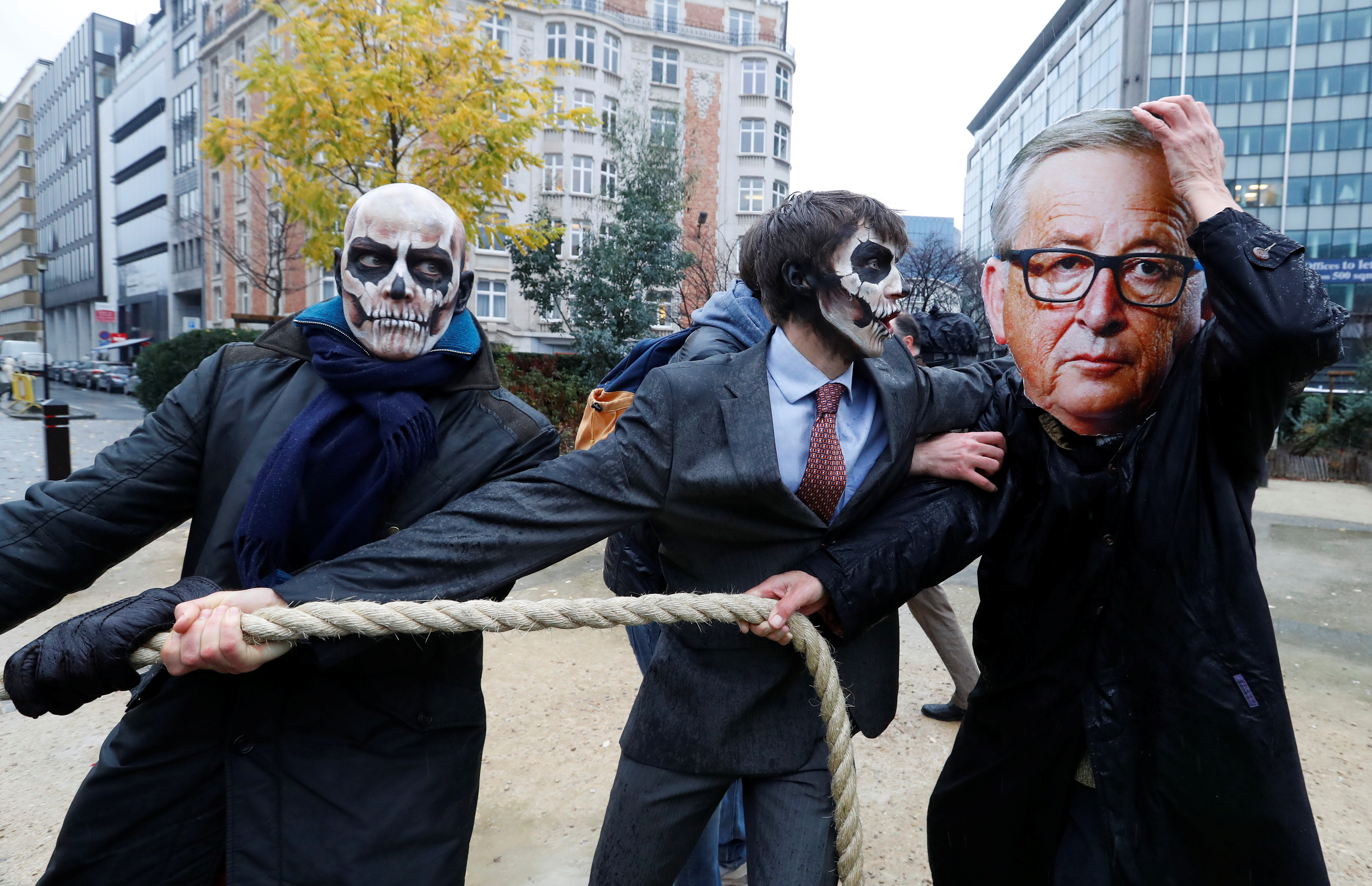 Protestors wearing skulls and European Commission President Jean-Claude Juncker demonstrate against a five-year extension of the license for weed-killer glyphosate that the European Commission will propose on Monday, in Brussels, Belgium, November 27, 2017. REUTERS/Yves Herman - RC11837E82B0
