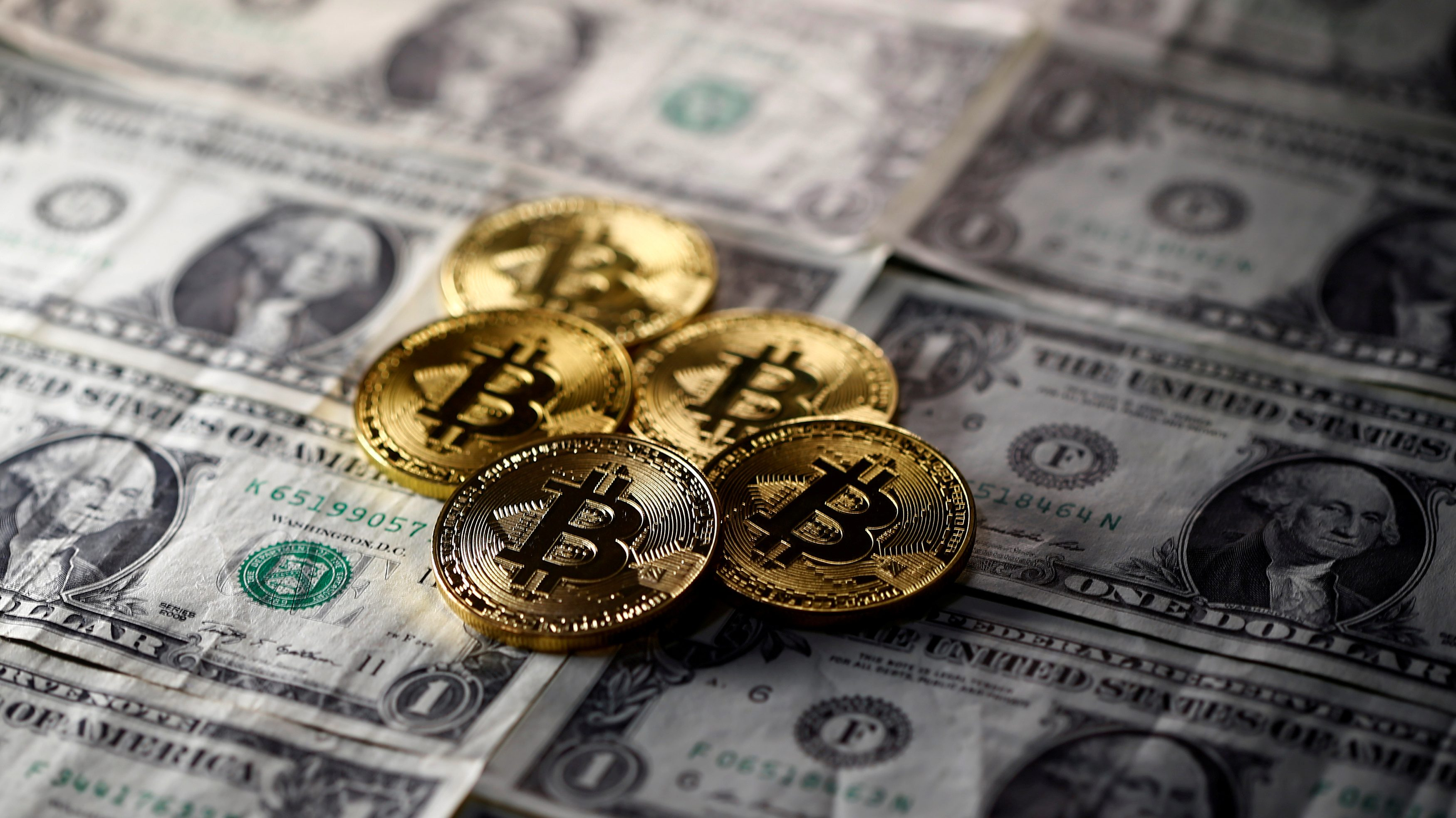 FILE PHOTO: Bitcoin (virtual currency) coins placed on Dollar banknotes are seen in this illustration picture, November 6, 2017. REUTERS/Dado Ruvic/Illustration/File Photo - RC14C93905D0
