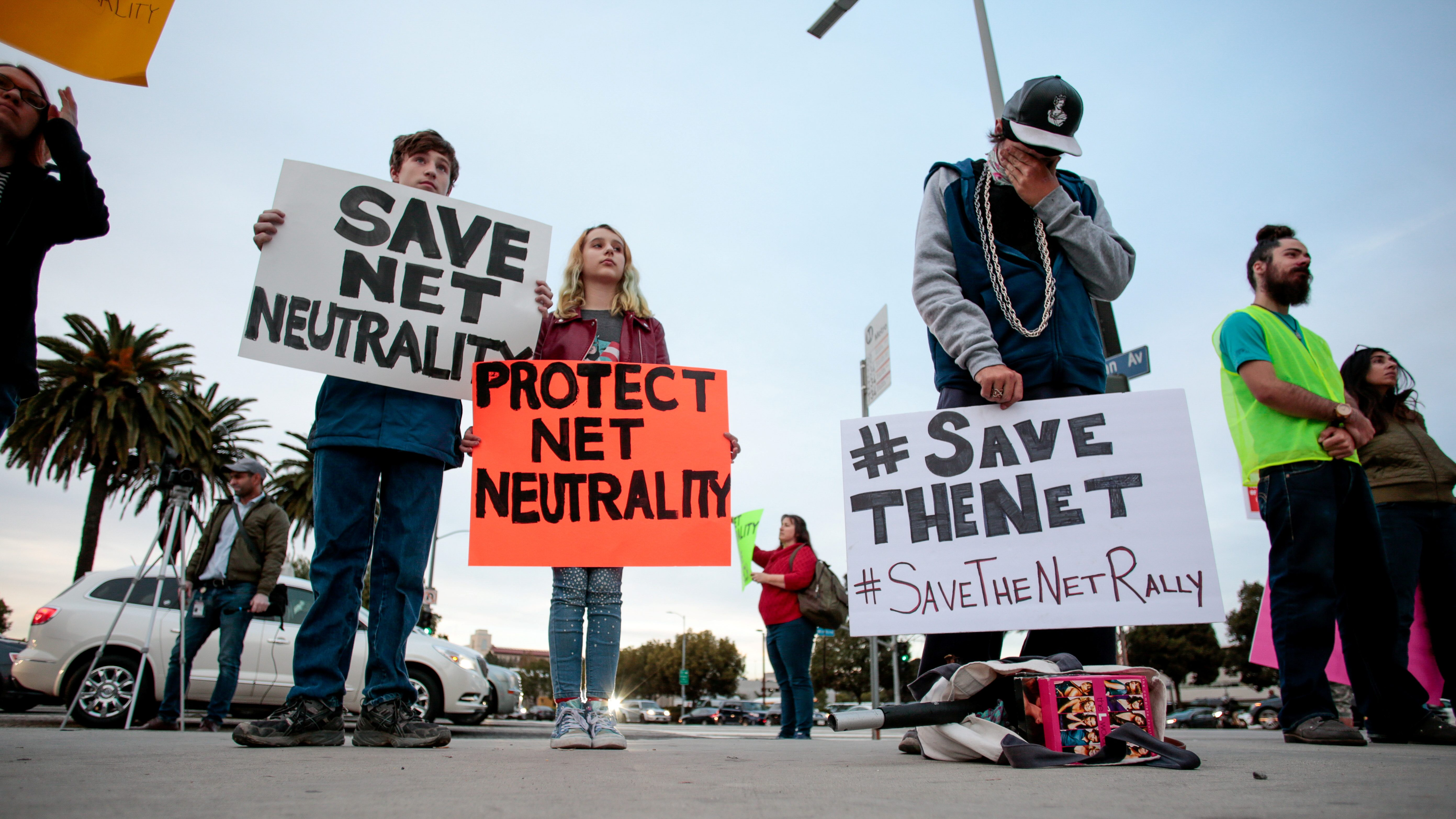 Supporters of Net Neutrality protest the FCC's recent decision to repeal the program in Los Angeles, California, November 28, 2017. REUTERS/ Kyle Grillot - RC1F4D196190