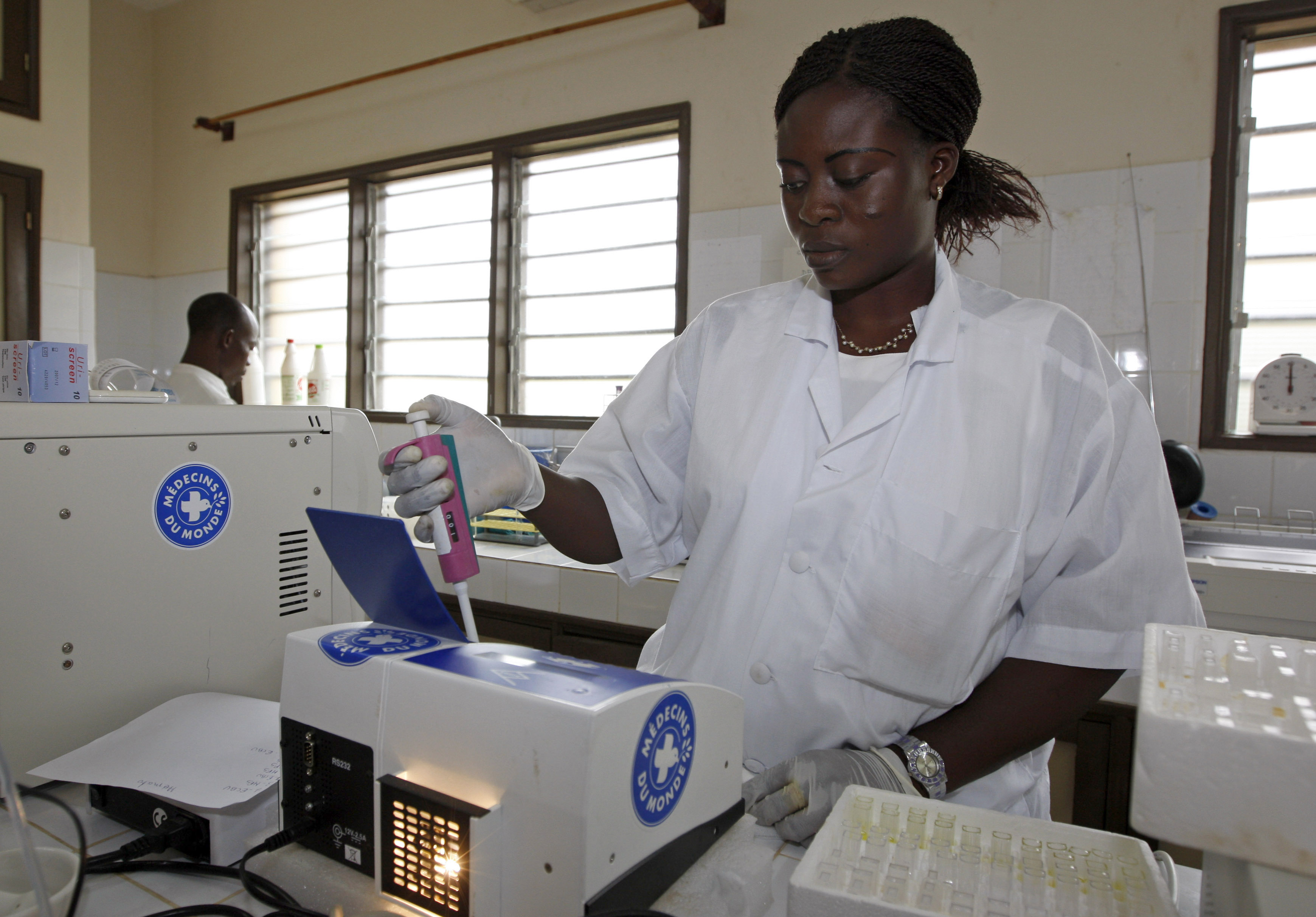 A medical personnel working with Medecin de Monde conducts HIV tests at Ouidah's hospital near Cotonou