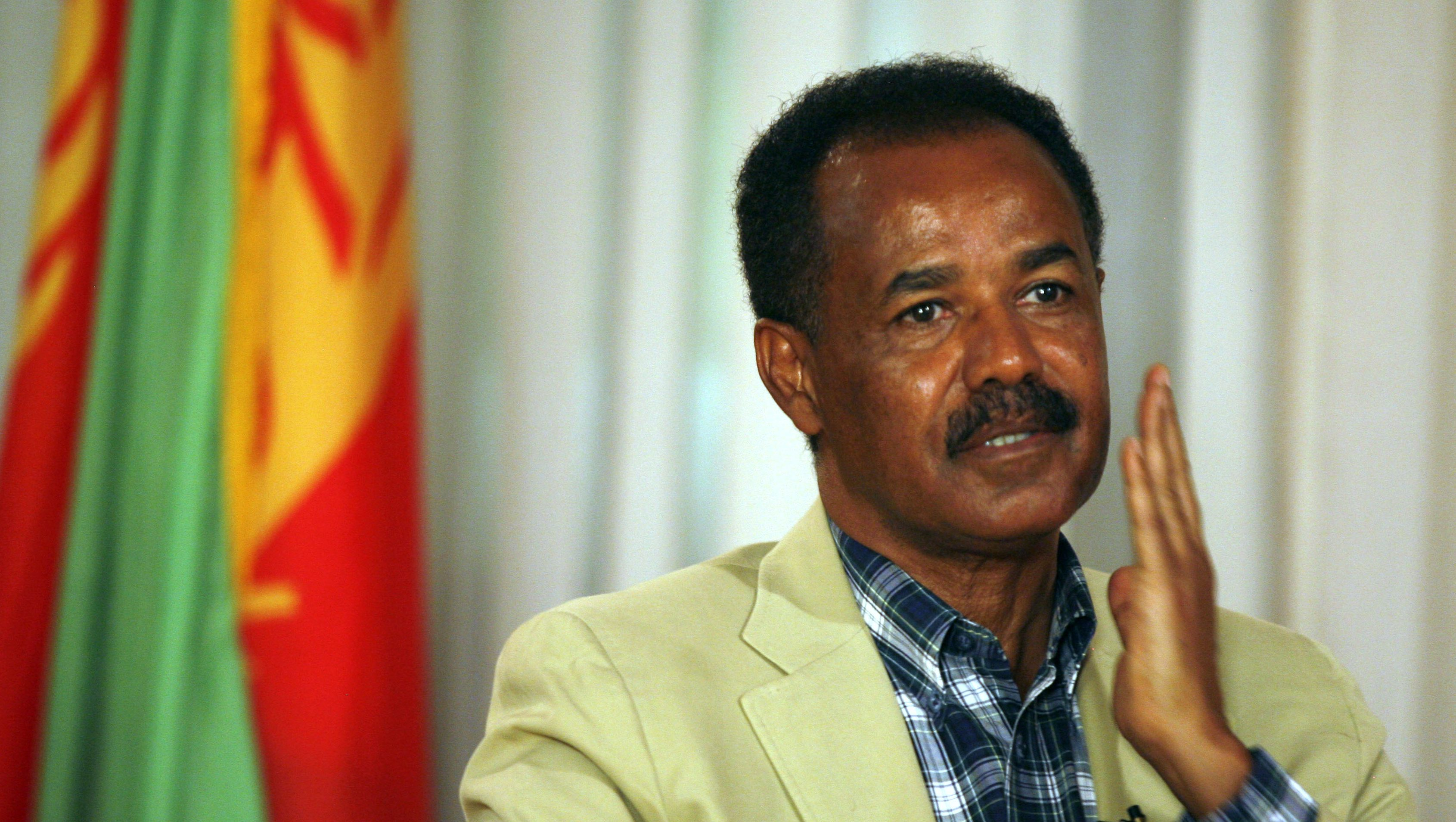 "Eritrea's President Isaias Afwerki gestures during an interview in Asmara May 13, 2008. U.N. fears that a pullout of peacekeepers on the Eritrea-Ethiopia border may lead to a new war are unfounded scaremongering and a ""gimmick"" to cover the world body's failings, Afwerki said on Tuesday."
