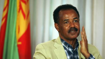 """Eritrea's President Isaias Afwerki gestures during an interview in Asmara May 13, 2008. U.N. fears that a pullout of peacekeepers on the Eritrea-Ethiopia border may lead to a new war are unfounded scaremongering and a """"gimmick"""" to cover the world body's failings, Afwerki said on Tuesday."""