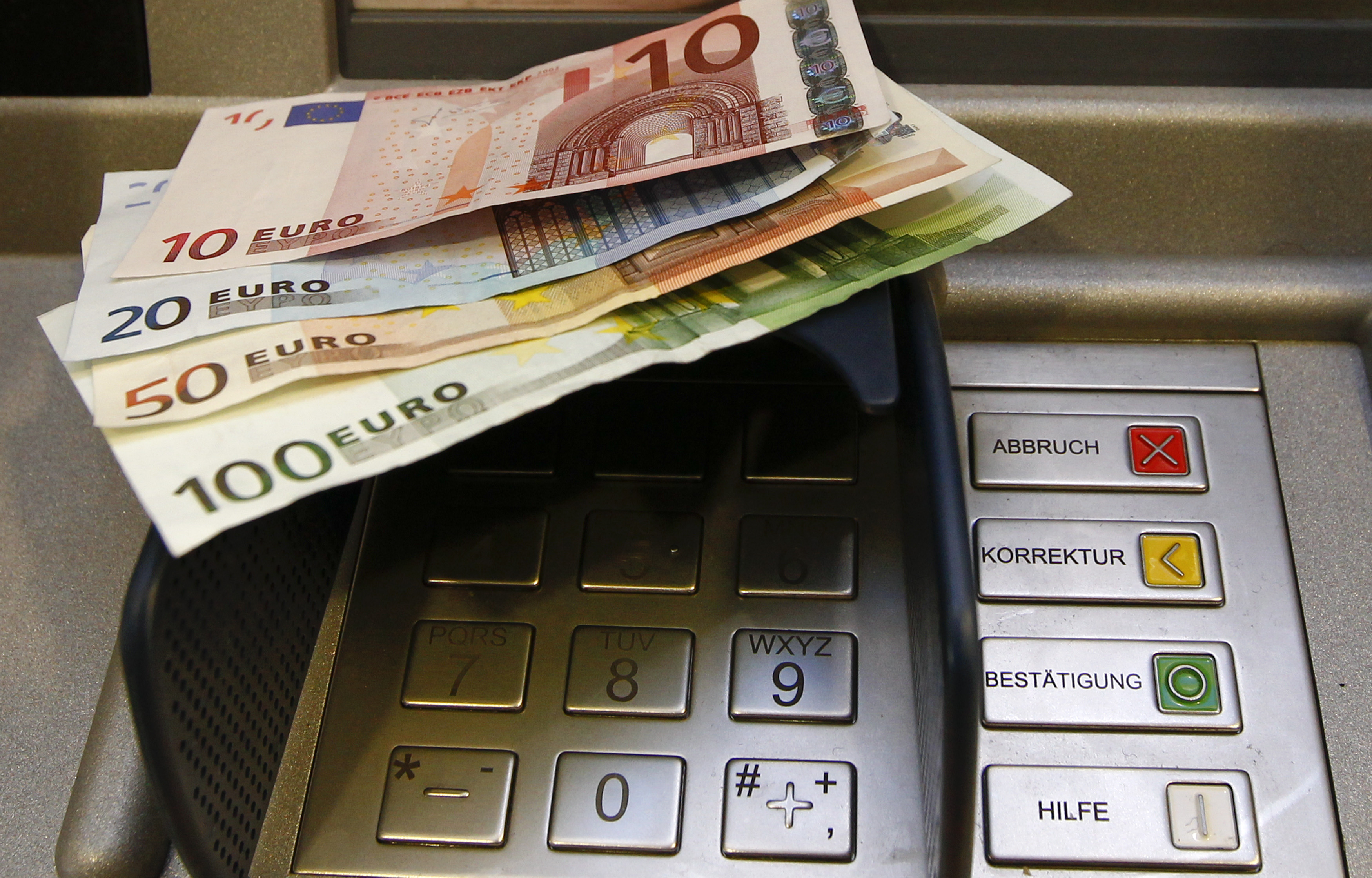 A picture illustration of Euro banknotes seen at an automated teller machine (ATM) in Berlin January 15, 2011. Starting January 15, teller machines in Germany must display the transaction fees to customers who are not clients of the bank, according to a new law.