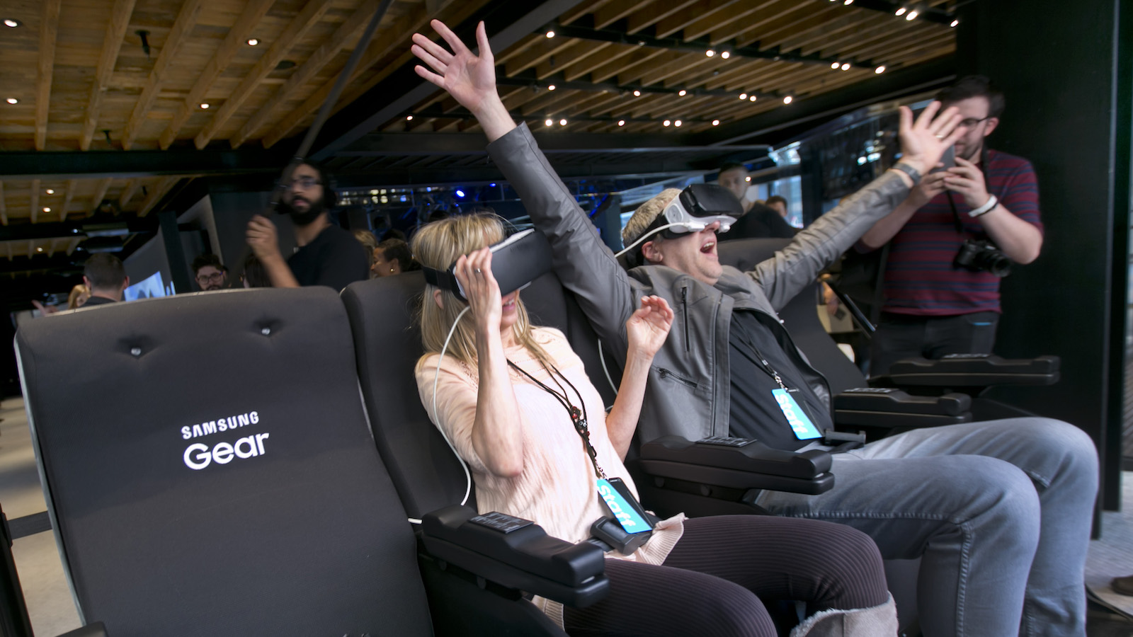 """Samsung Gear VR 4D chairs are demonstrated during a preview of Samsung's flagship store, Samsung 837, in New York's Meatpacking District, Monday, Feb 22, 2016. Samsung is opening what it calls a """"technology playground"""" in New York for customers to check out its latest gadgets. The center opens Tuesday, the day Samsung starts taking orders for its upcoming Galaxy S7 and S7 Edge phones. (AP Photo/Richard Drew)"""