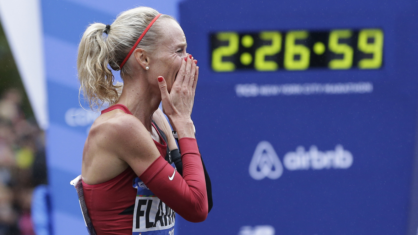 Shalene Flanagan of the United States reacts after crossing the finish line first in the women's division of the New York City Marathon in New York, Sunday, Nov. 5, 2017. (AP Photo/Seth Wenig)