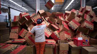An employee works at a Tmall logistic centre in Suzhou, Jiangsu province, China, October 28, 2015. On China's giant Singles Day internet shopping festival, the country's delivery firms are stretched so thin that they are looking for tie-ups, listings and new investors to husband their resources. E-commerce has been a huge boon to the logistics industry, but the ever-bigger Singles Day, run by leading online market company Alibaba Group Holding Ltd on Nov. 11 every year, exacerbates the industry's twin dilemmas of cut-throat competition and rising labor costs. With low barriers to entry, express couriers proliferated rapidly over the past decade to more than 8,000 firms, squeezing profit margins to about 5 percent, down from 30 percent 10 years ago, according to analysts. Picture taken October 28, 2015. To match CHINA-SINGLES DAY/LOGISTICS REUTERS/Aly Song