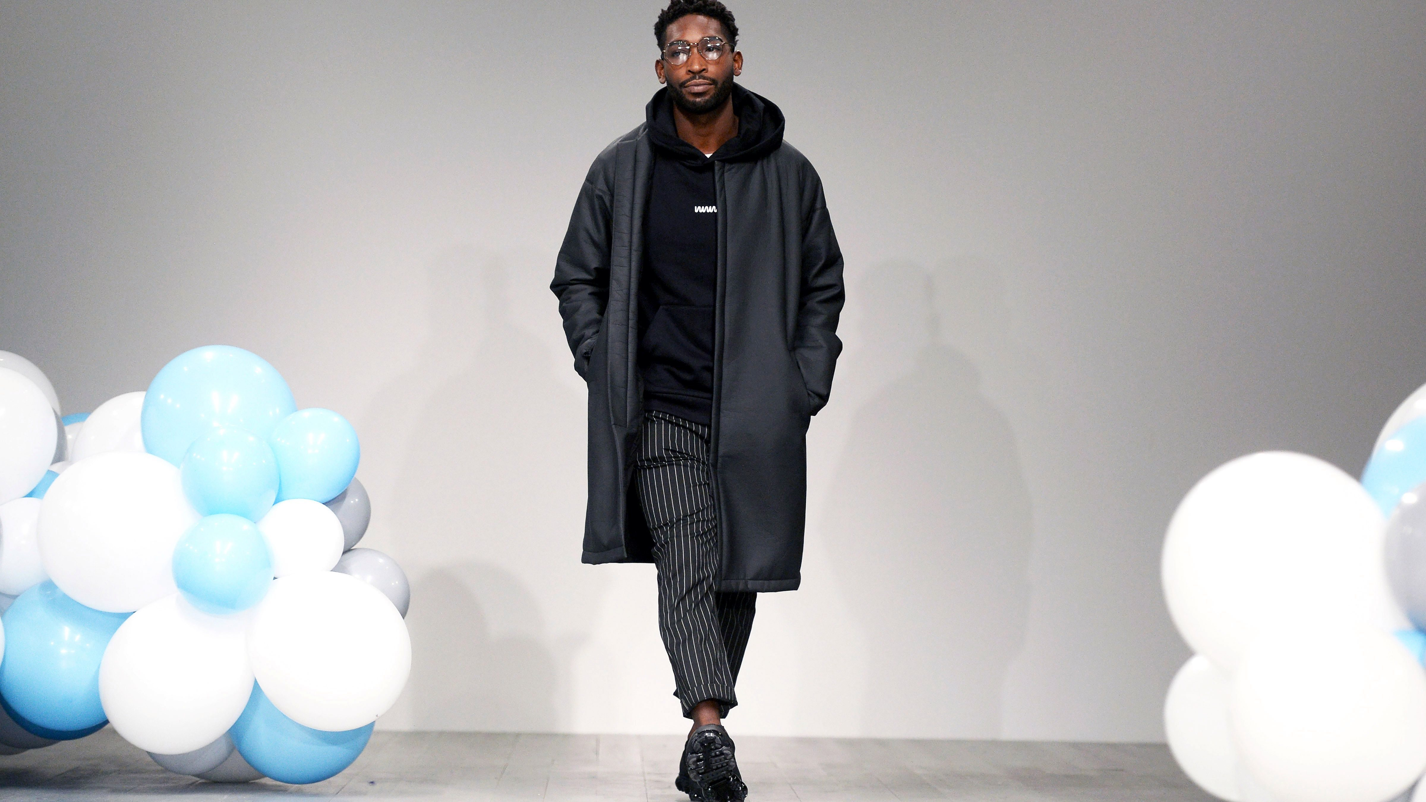 Tinie Tempah displays a creation from his own What We Wear show at London Fashion Week Men's in London, Britain