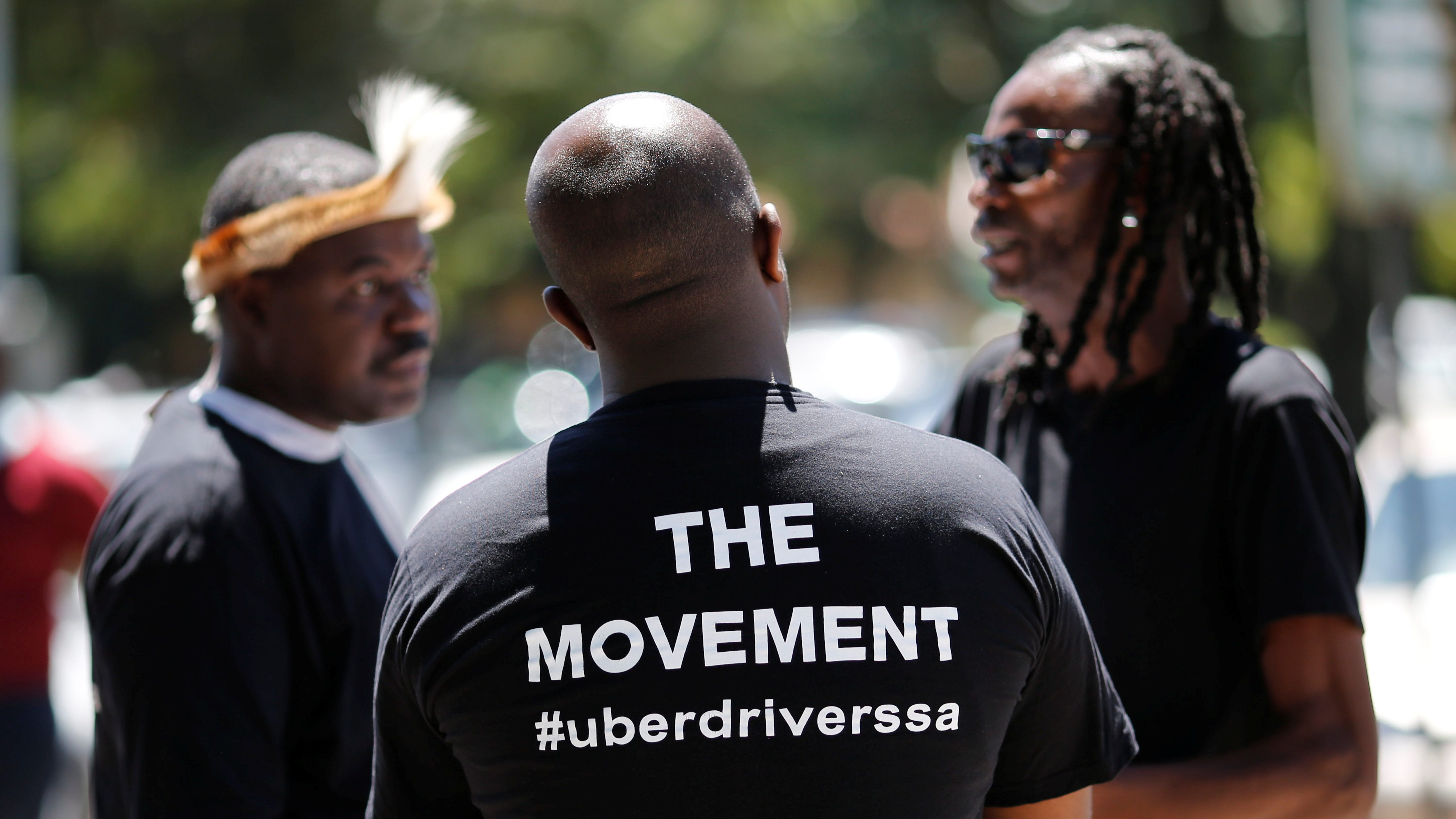Uber drivers gather outside the company's offices in Parktown, a suburb of Johannesburg