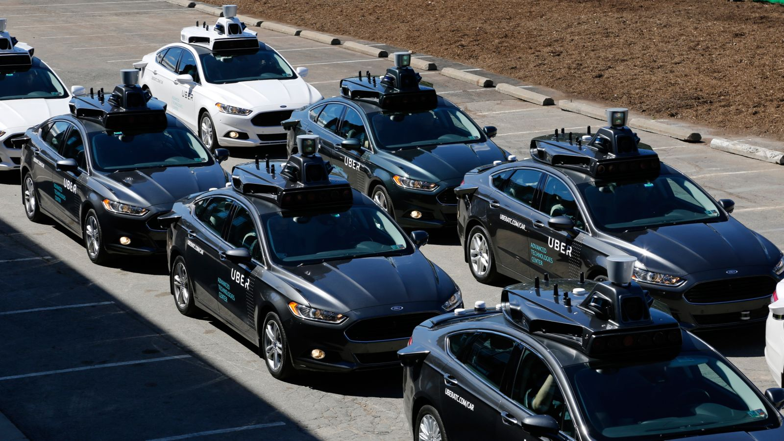 A group of self driving Uber vehicles position themselves to take journalists on rides during a media preview at Uber's Advanced Technologies Center in Pittsburgh, Monday, Sept. 12, 2016. (AP Photo/Gene J. Puskar)